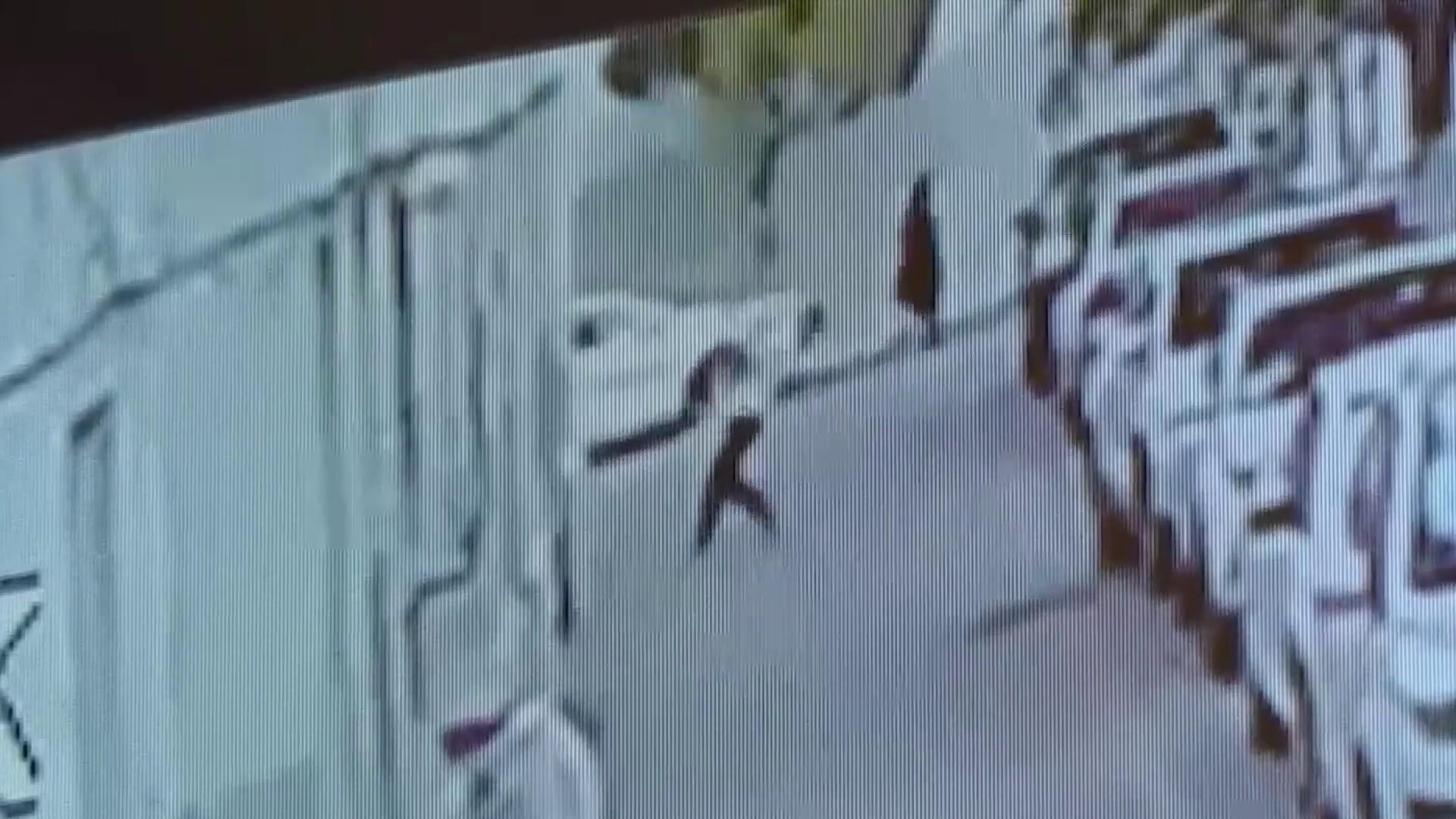 Dramatic video shows man rushing to save toddler falling from 5th floor window