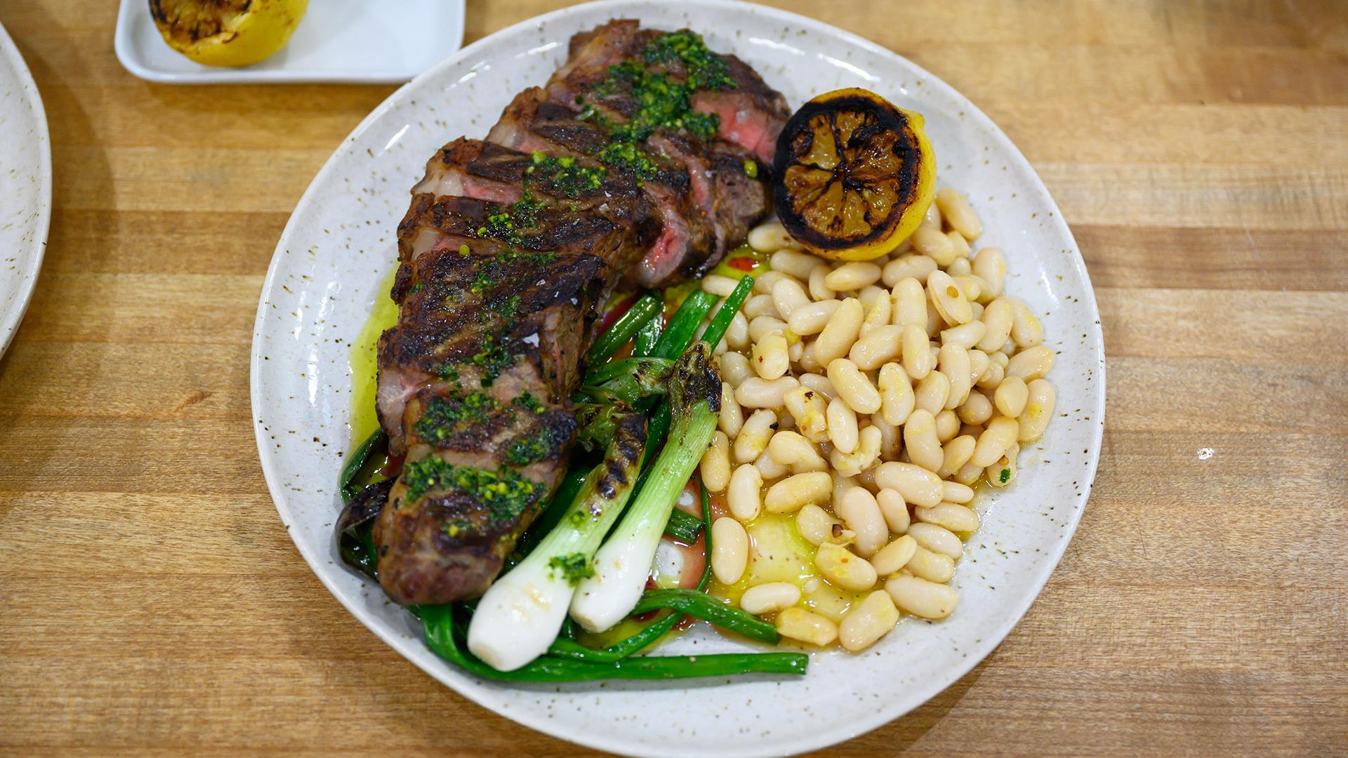 Grilling recipes: Make Tim Love's strip steak with beans and pesto
