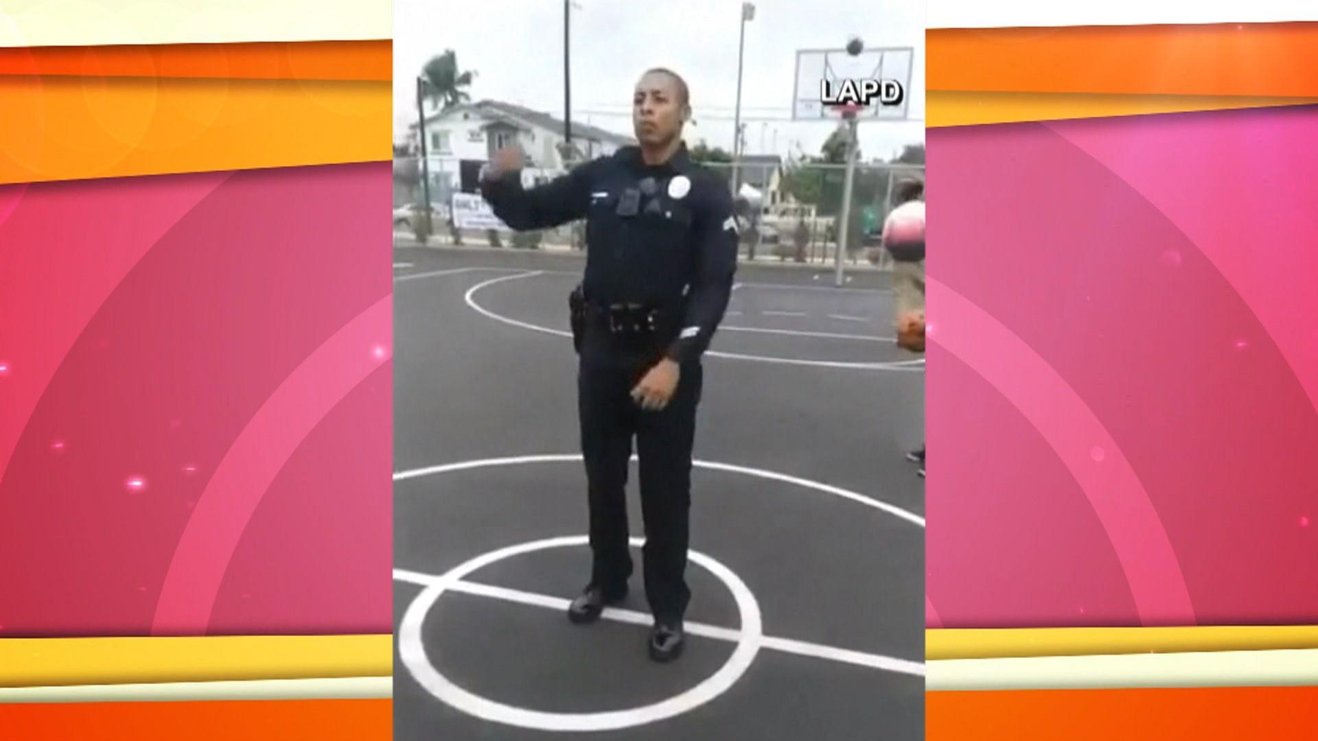 LAPD officer sinks backwards half-court shot