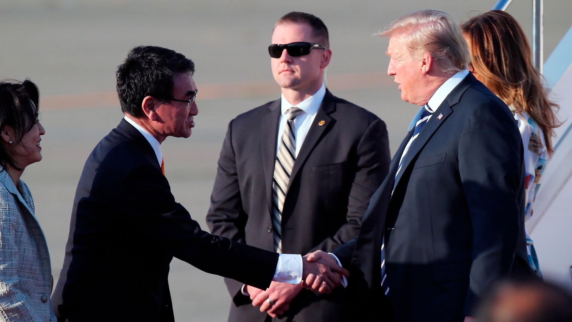President Trump arrives in Japan amid a big fight back in Washington