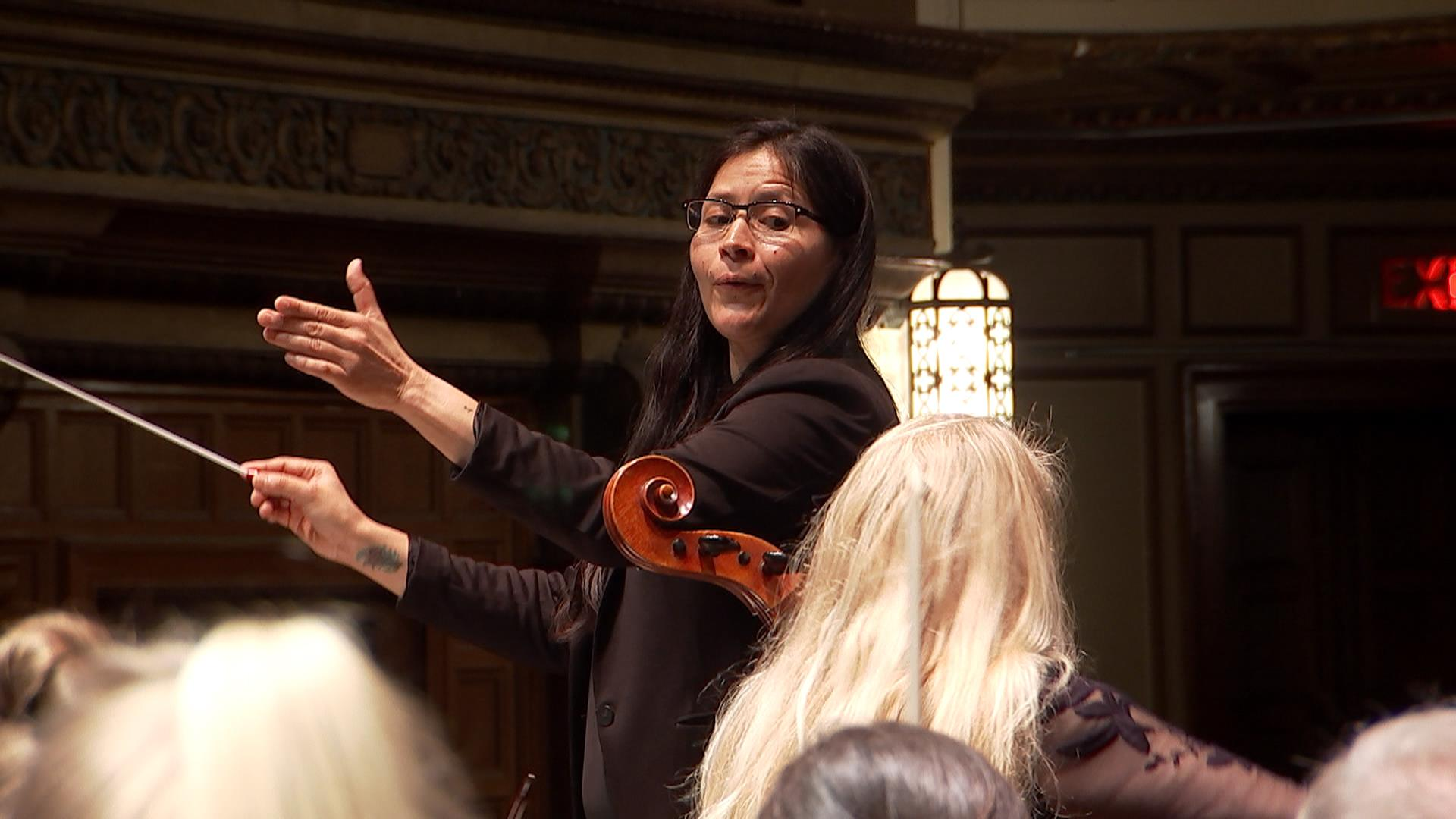 Meet the woman breaking barriers as a trailblazing symphony conductor