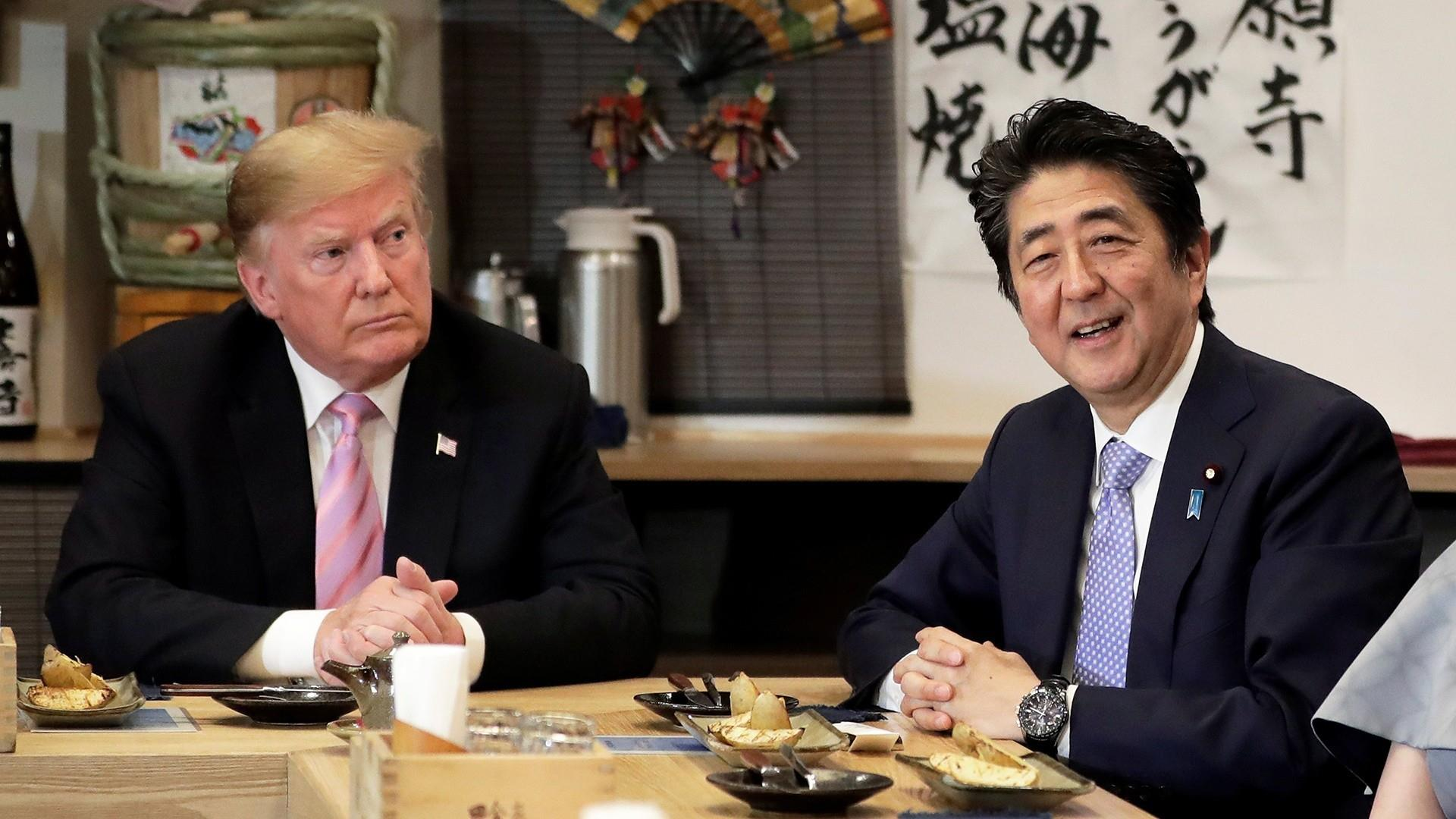 Trump plays golf, watches sumo wrestling during trip to Japan