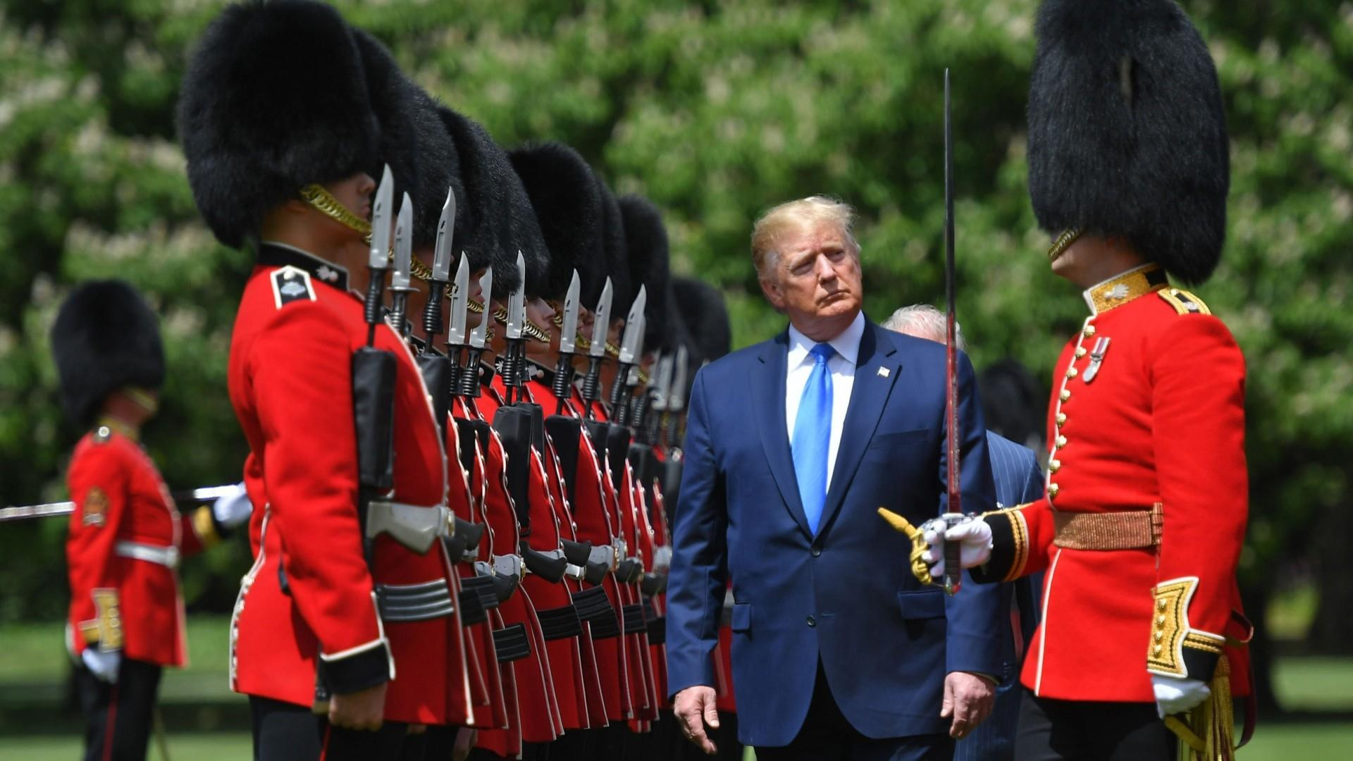 Trump's UK trip begins with ceremony, insults