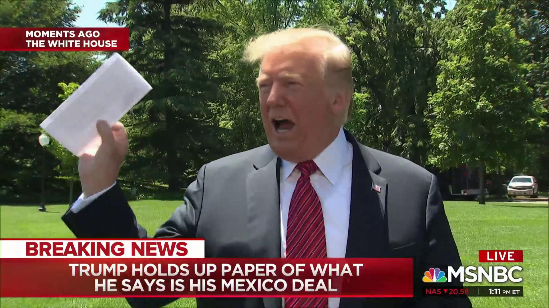 Trump waves around paper of what he says is Mexico deal