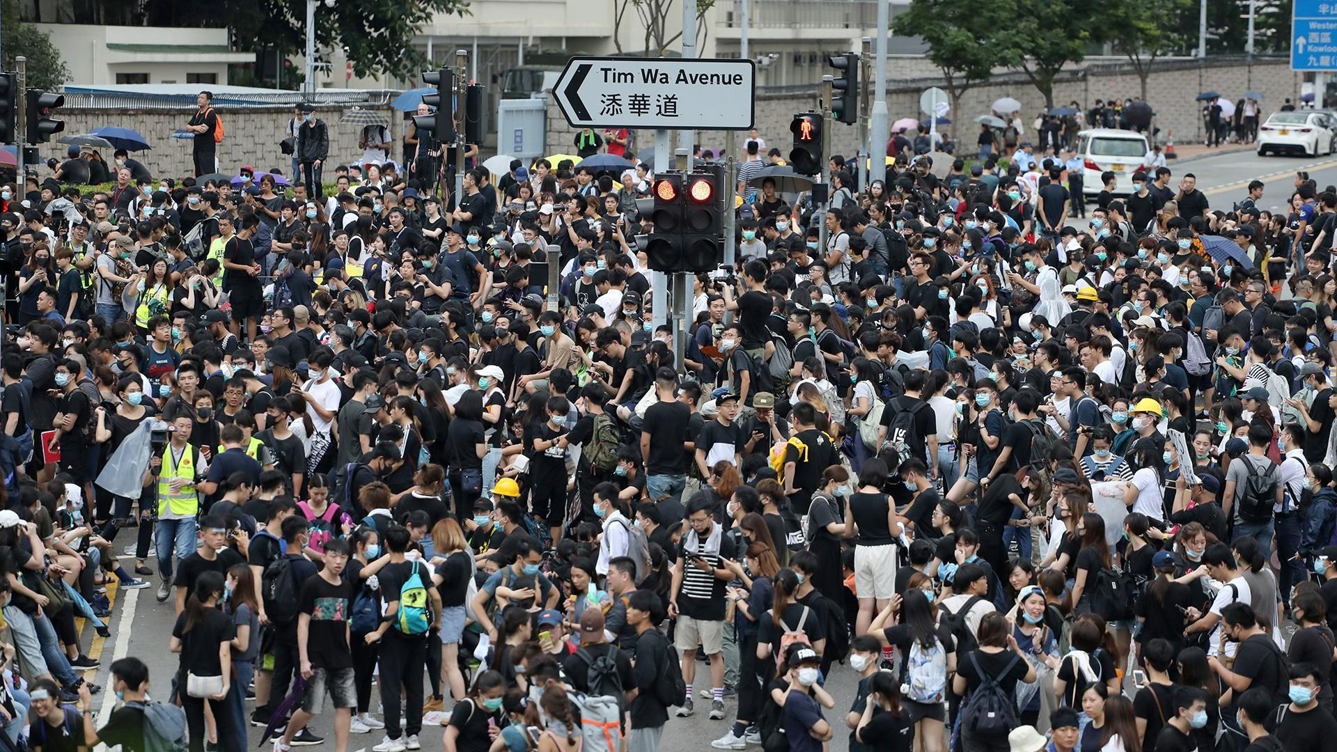 Massive protests flood Hong Kong