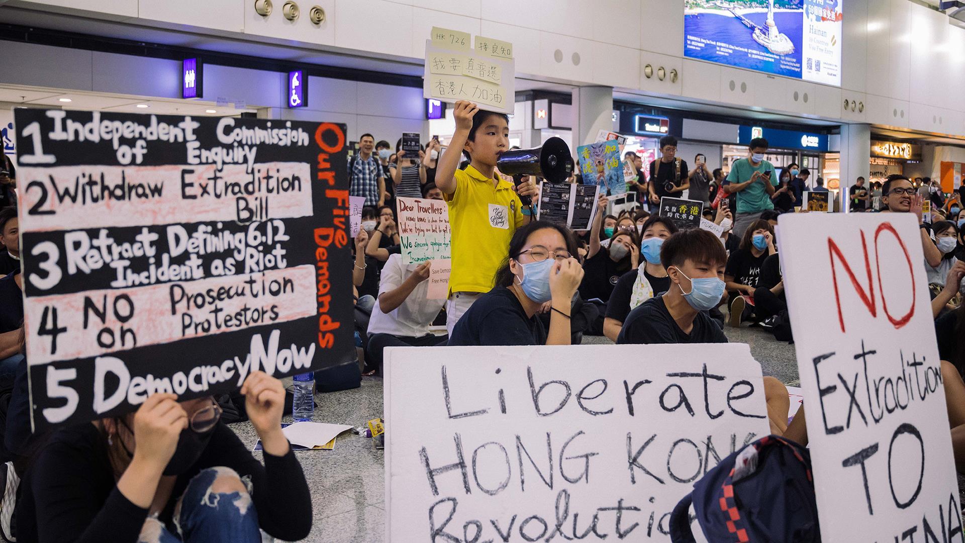 Pro-democracy demonstrators protest at Hong Kong airport