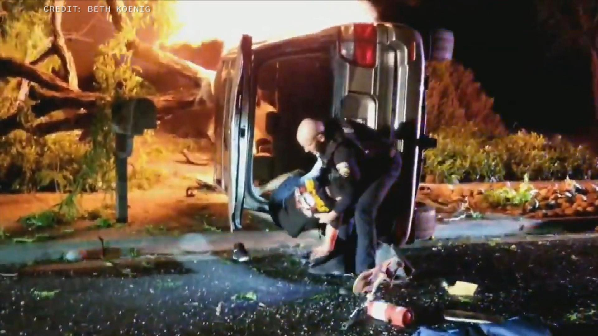 'We got to go!': Dramatic video shows California officer rescue driver from fiery crash