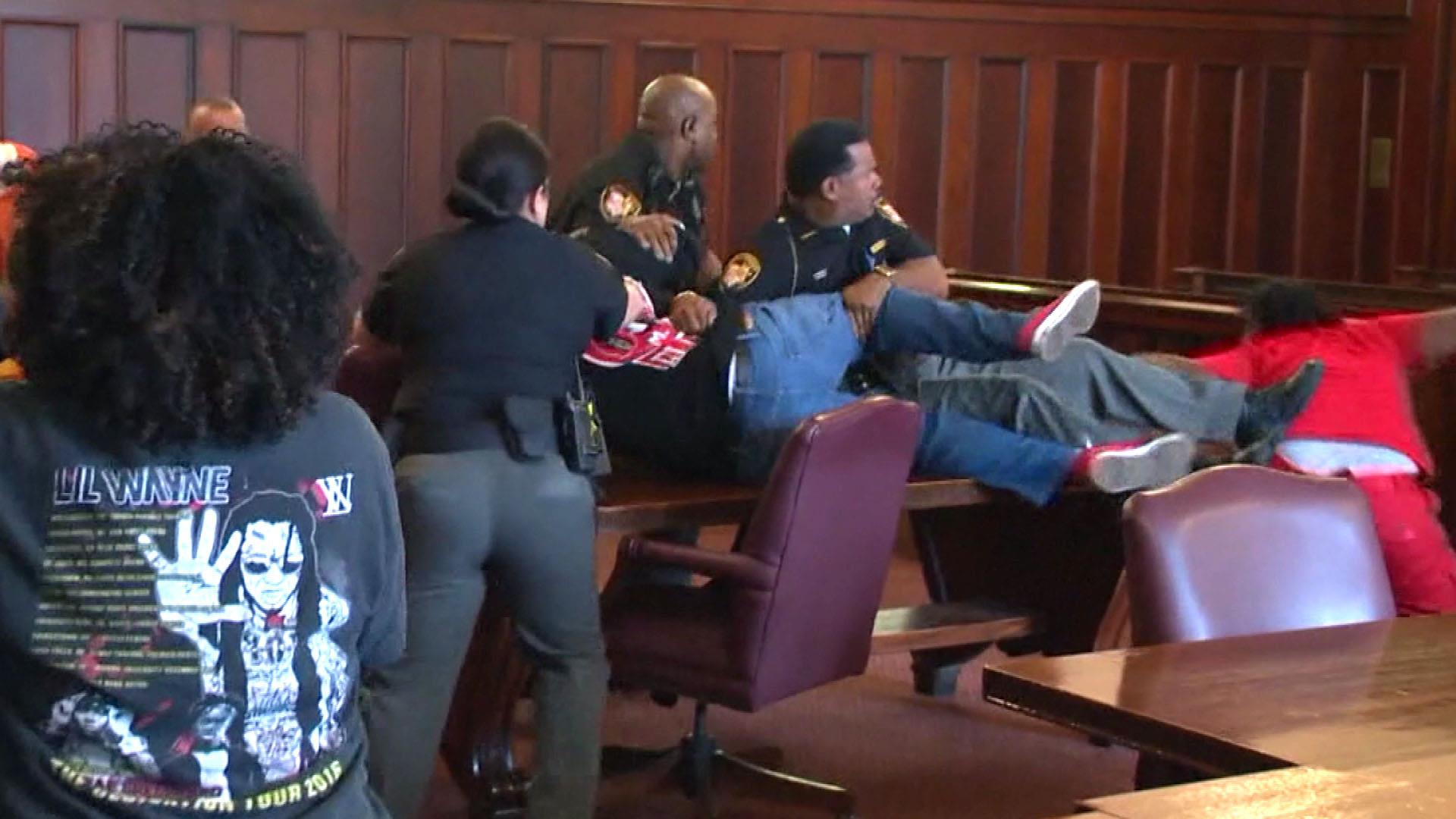 Murder victim's sons jump their mother's killer at hearing, attack captured on video