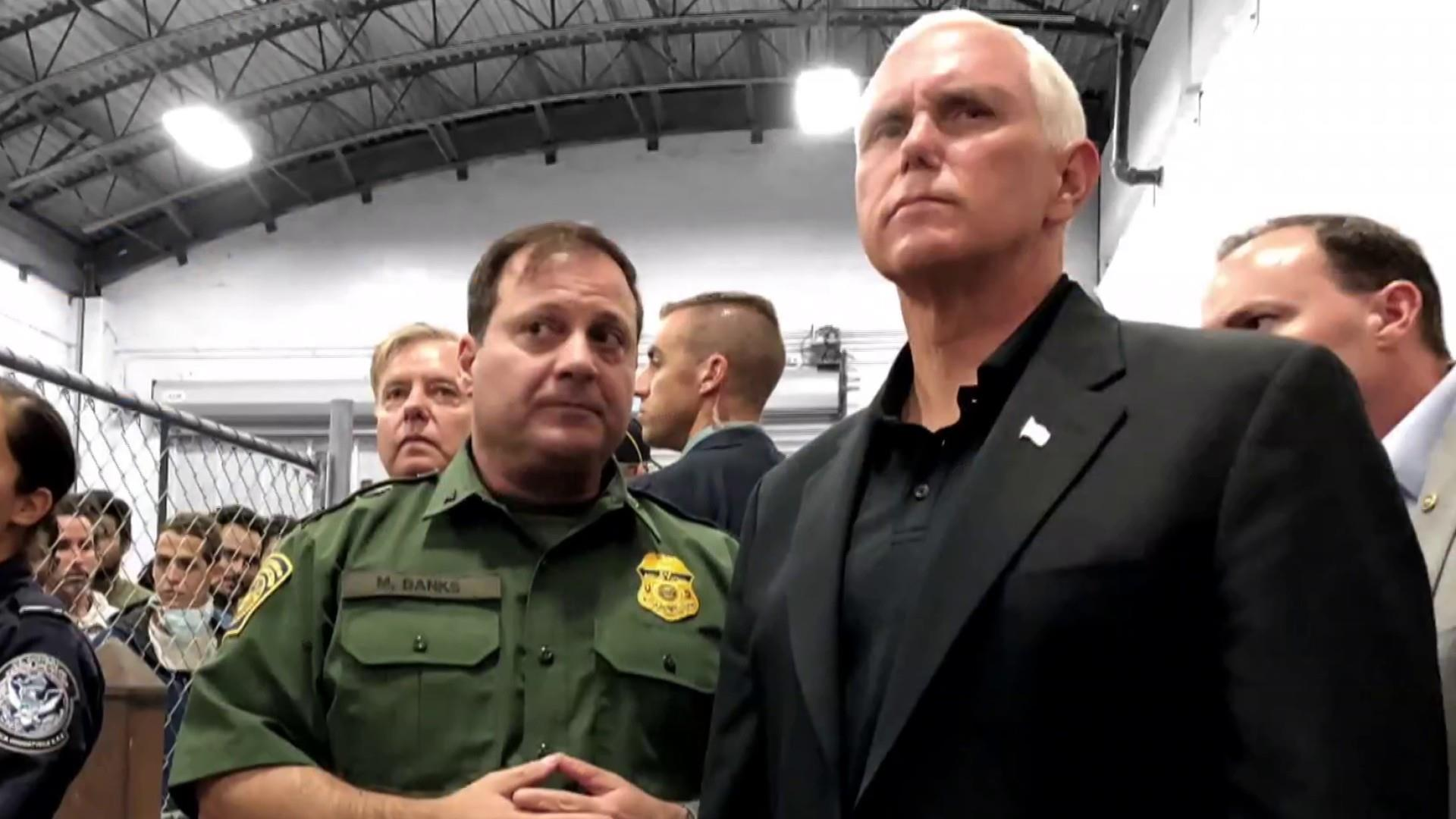 Trump's VP Pence stares blankly at nearly 400 migrants in overcrowded cages