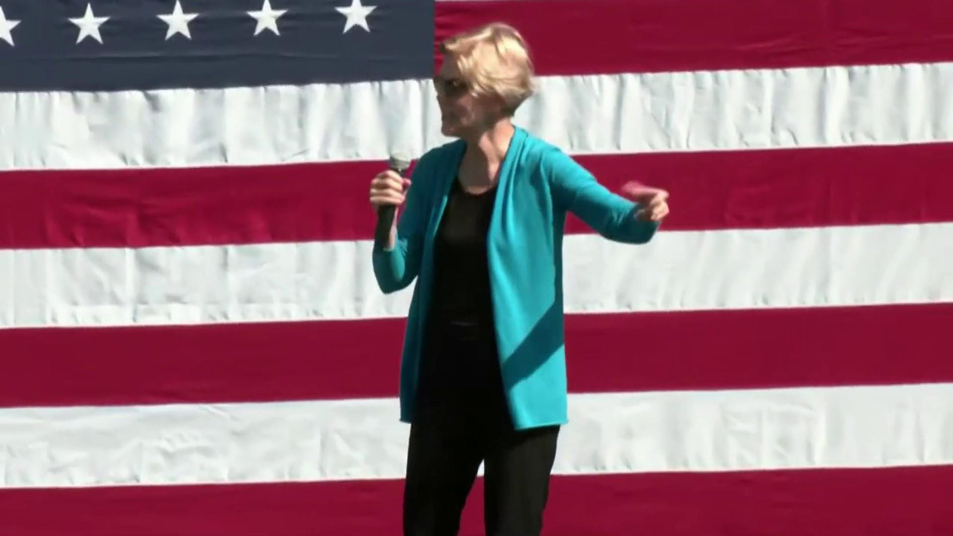 As Biden makes electability case, Warren draws biggest campaign crowd yet