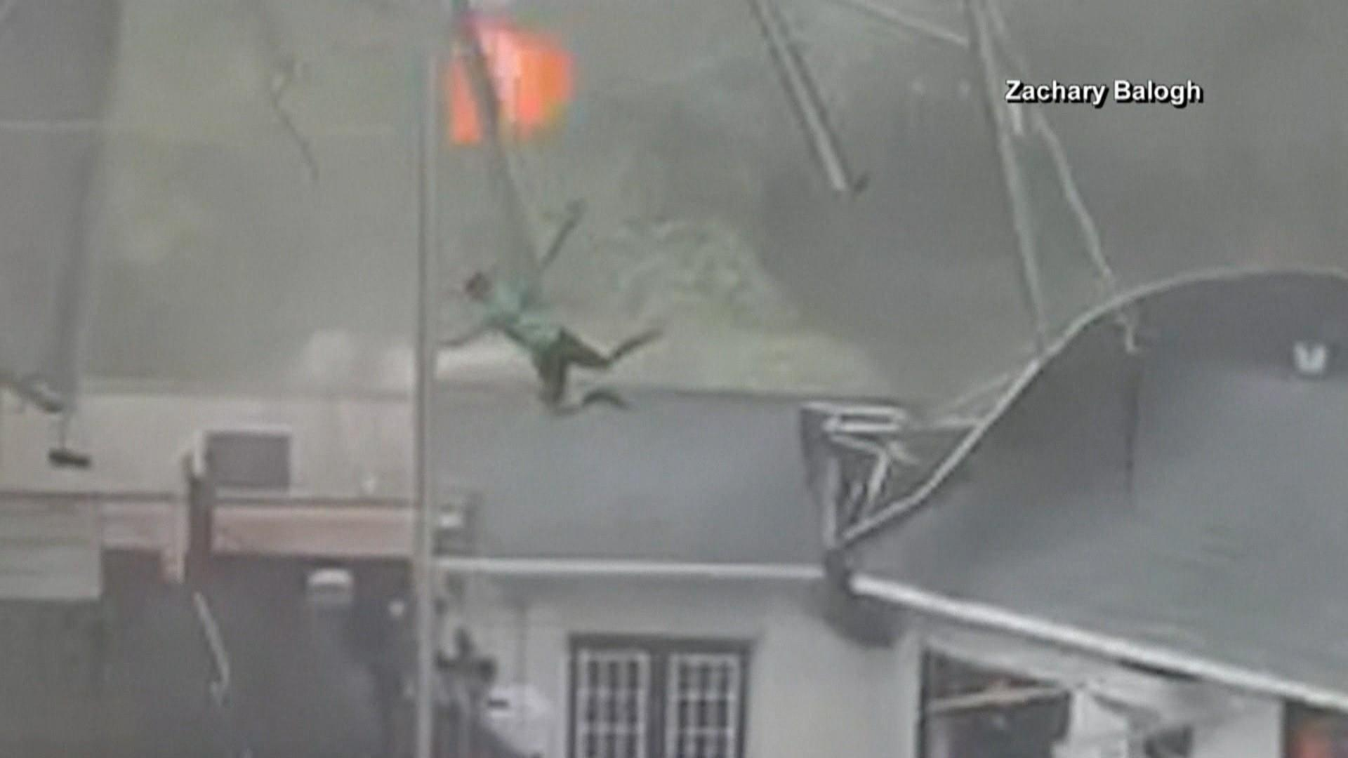 Powerful winds sweep away tent and 2 men in shocking video