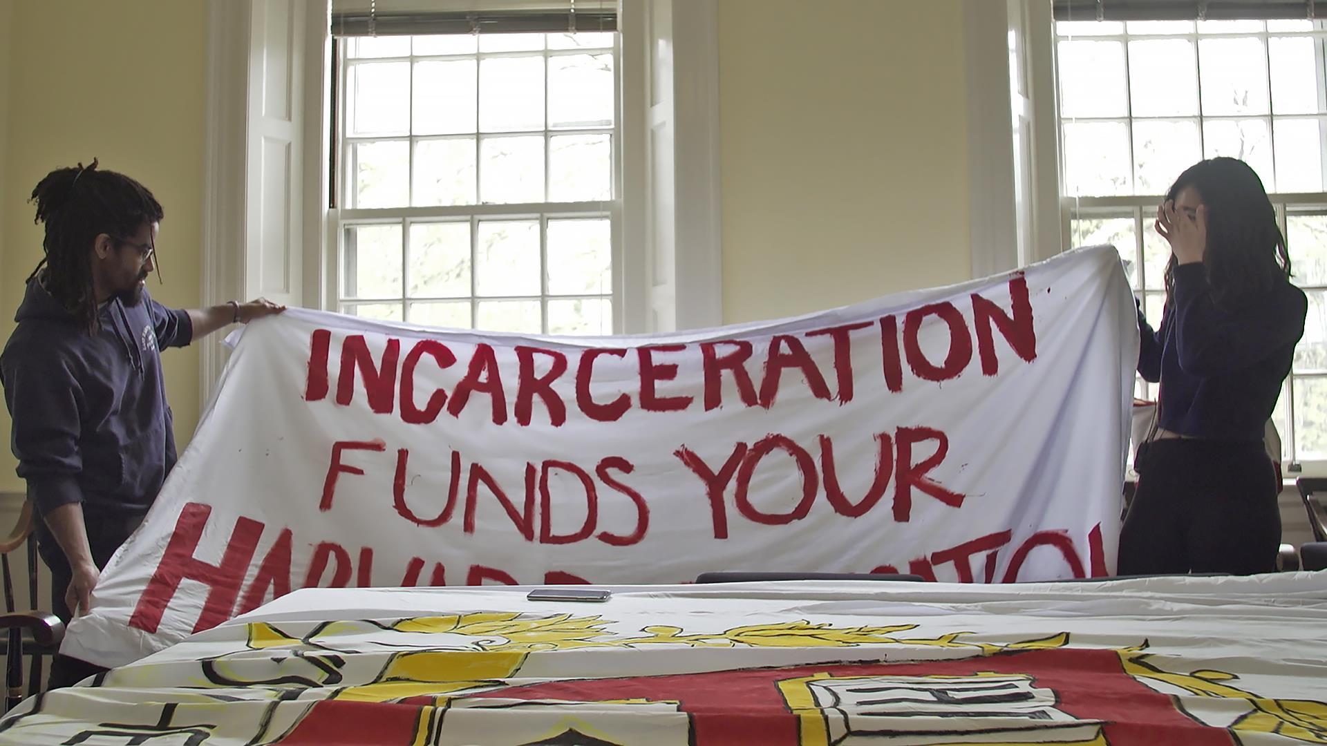 Harvard students to file lawsuit demanding school pull investments from prisons
