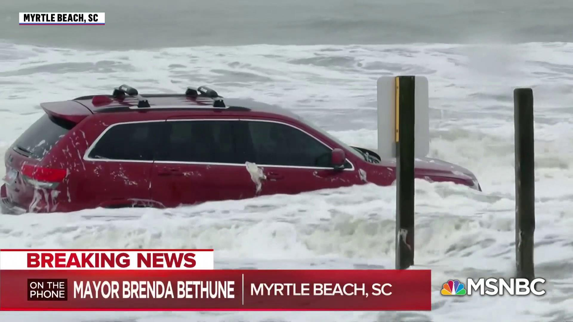 Waves from Hurricane Dorian toss around flooded Jeep on Myrtle Beach