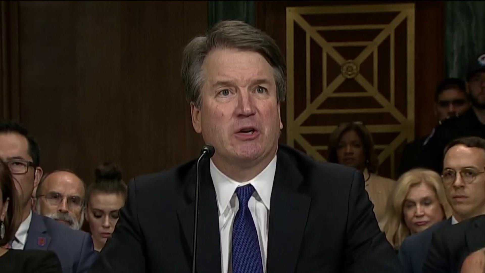 Trump defends Kavanaugh as 2020 Democrats call for his removal