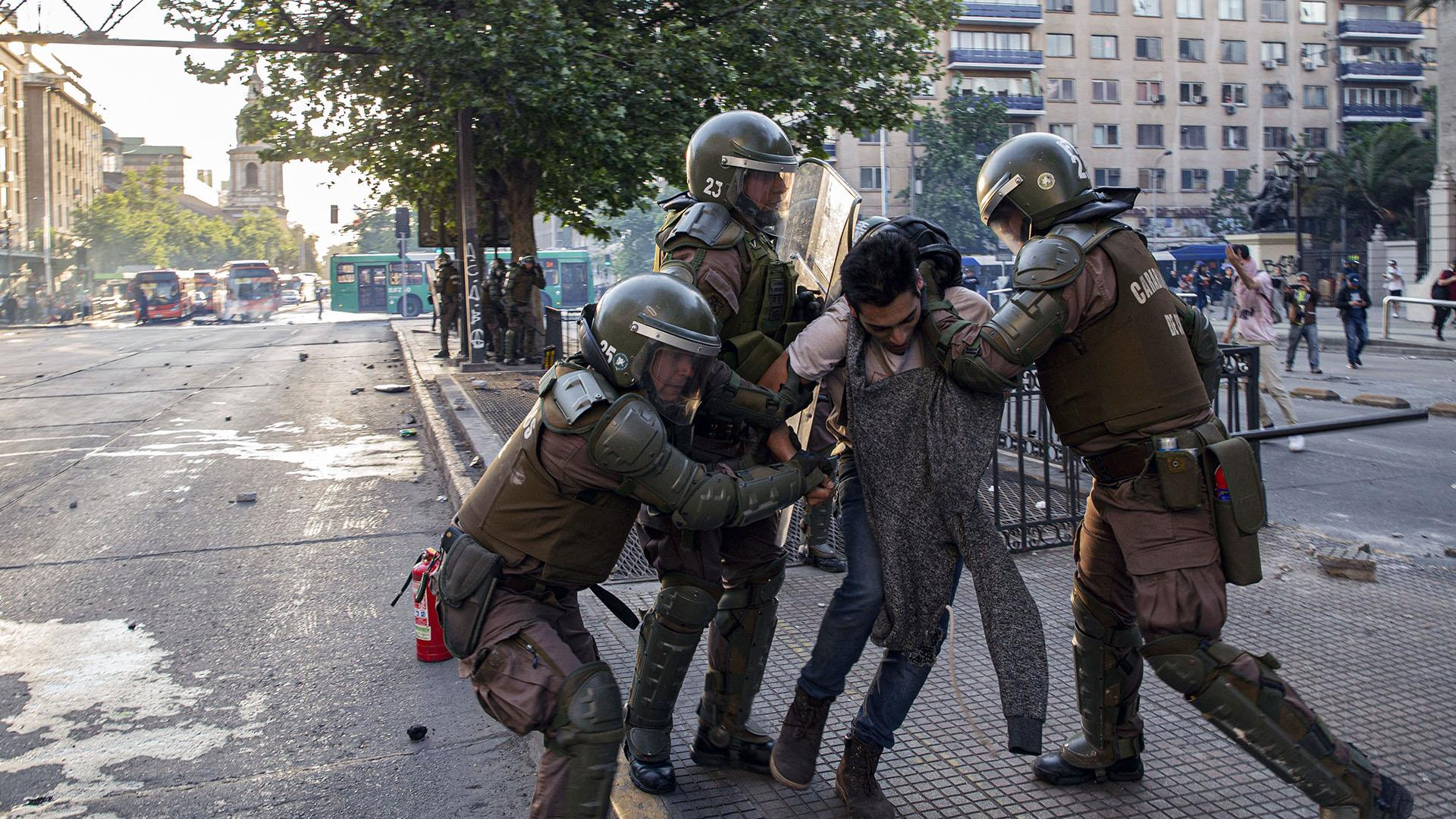 Riots in Chile leave at least three dead, state of emergency declared