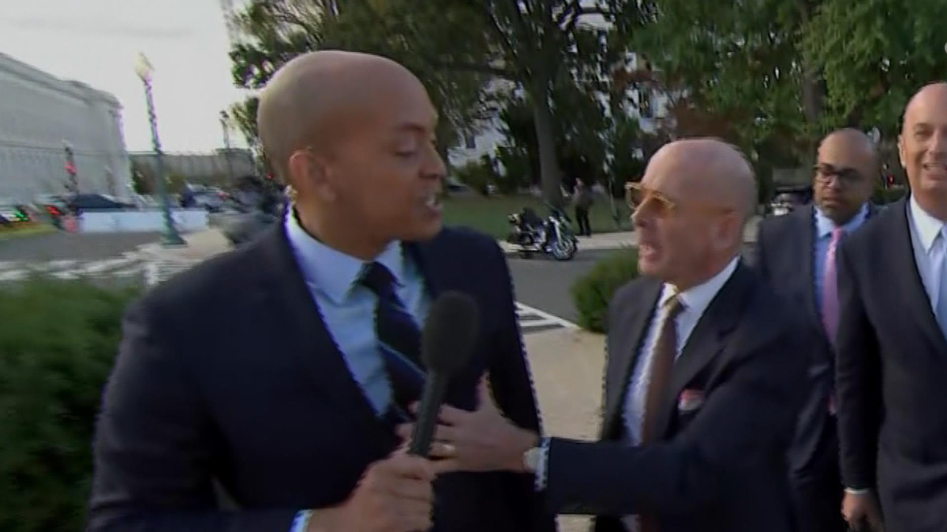 Man appears to push NBC's Geoff Bennett while he tries to question Gordon Sondland