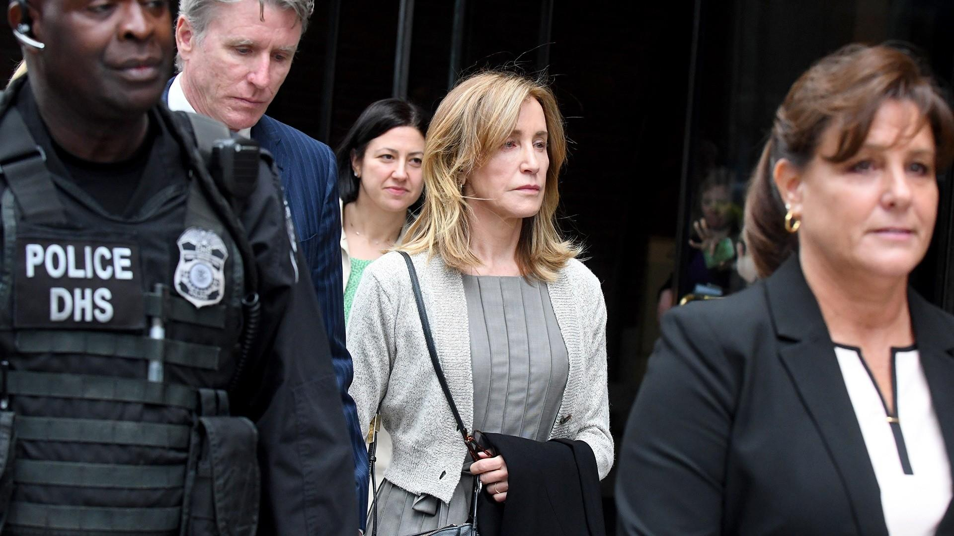 Felicity Huffman begins prison sentence for college admissions scam
