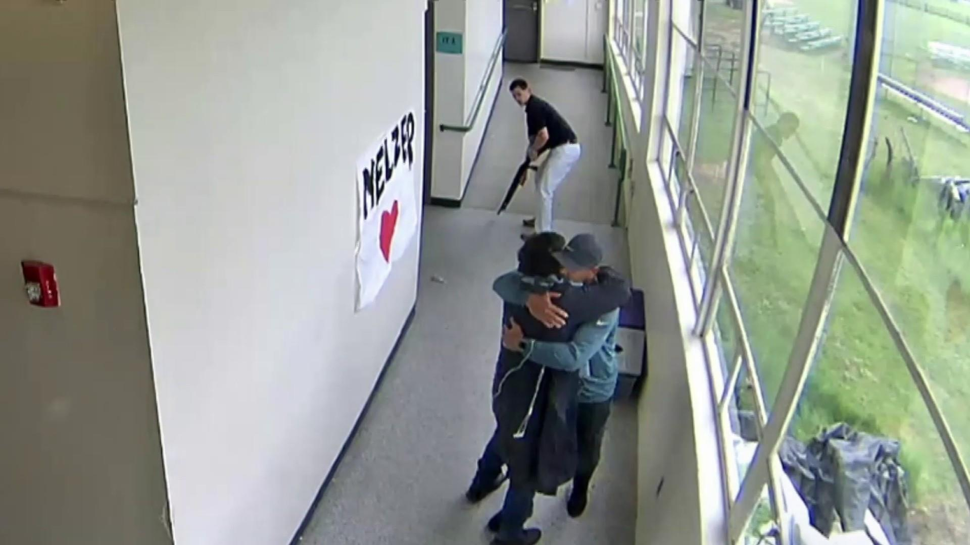 Video shows coach disarming a student with a loaded shotgun -- and then hugging him