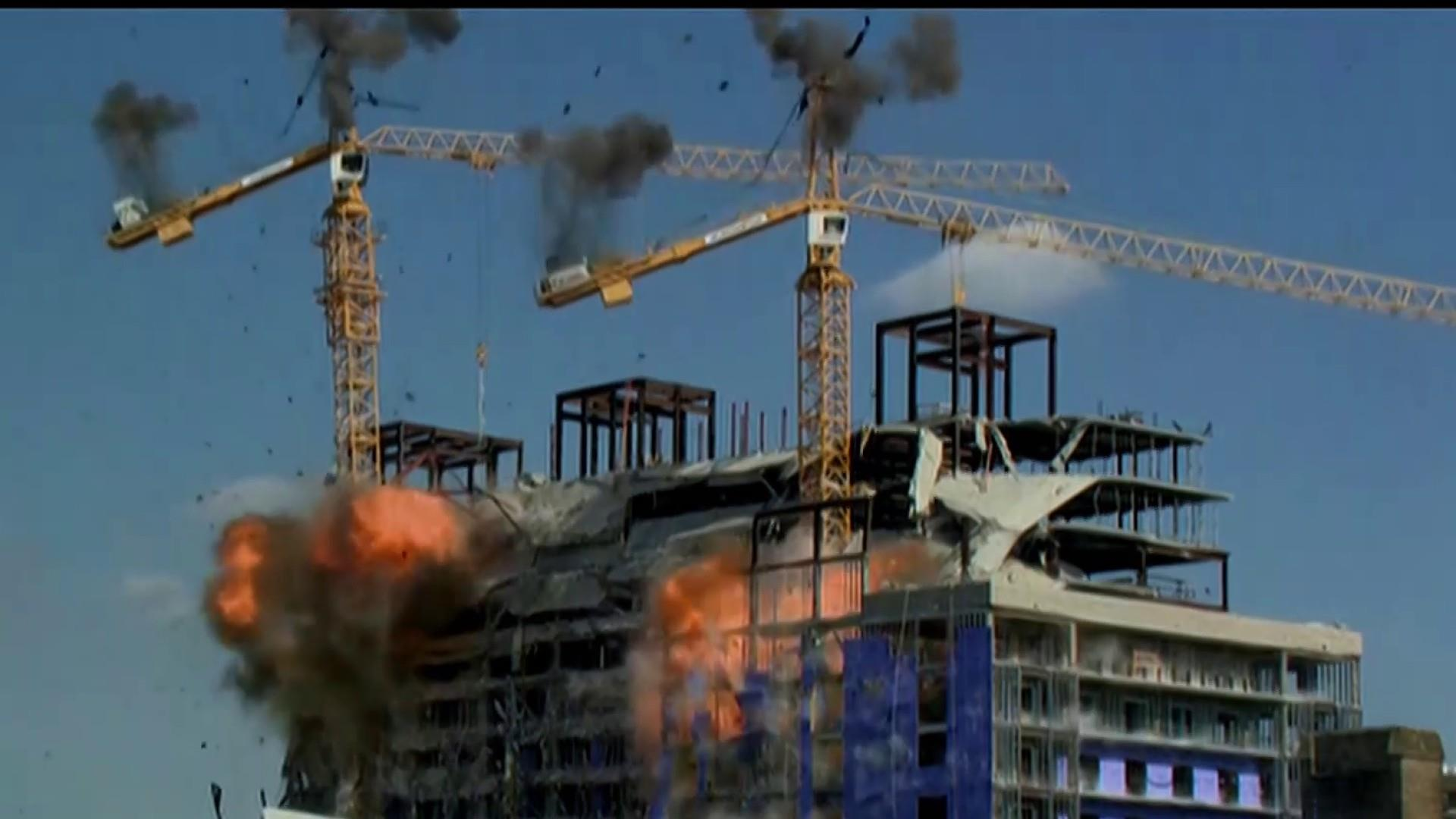 Controlled explosion brings down cranes at New Orleans hotel collapse site