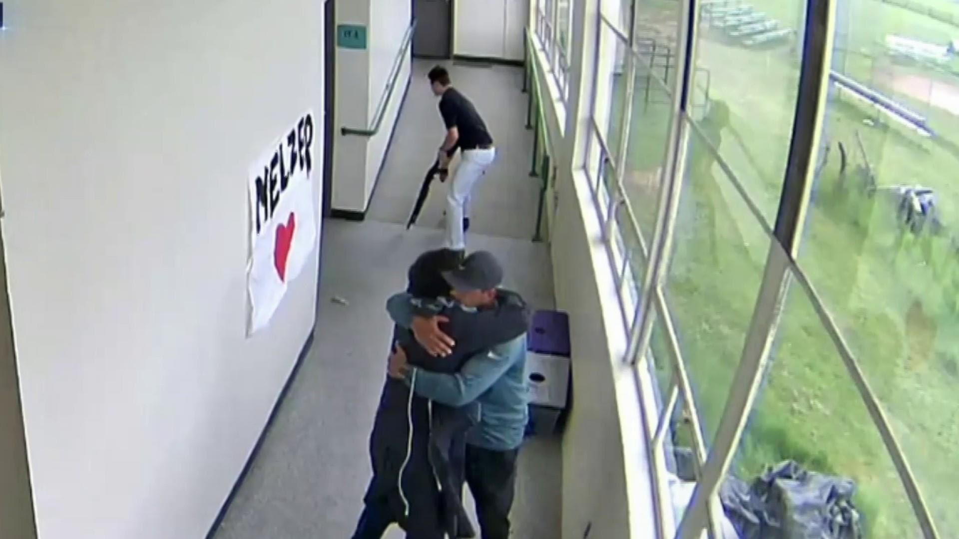 Video shows moment Oregon coach disarmed and hugged student with gun