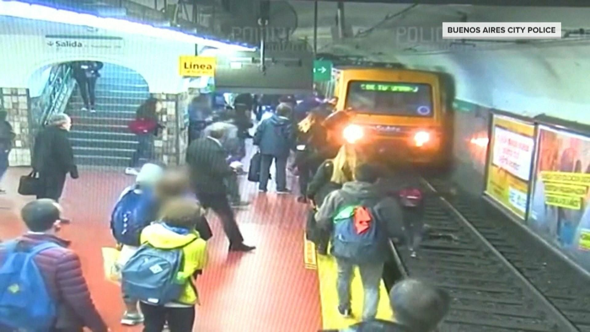 Watch commuters in Argentina help to save woman who falls onto the tracks