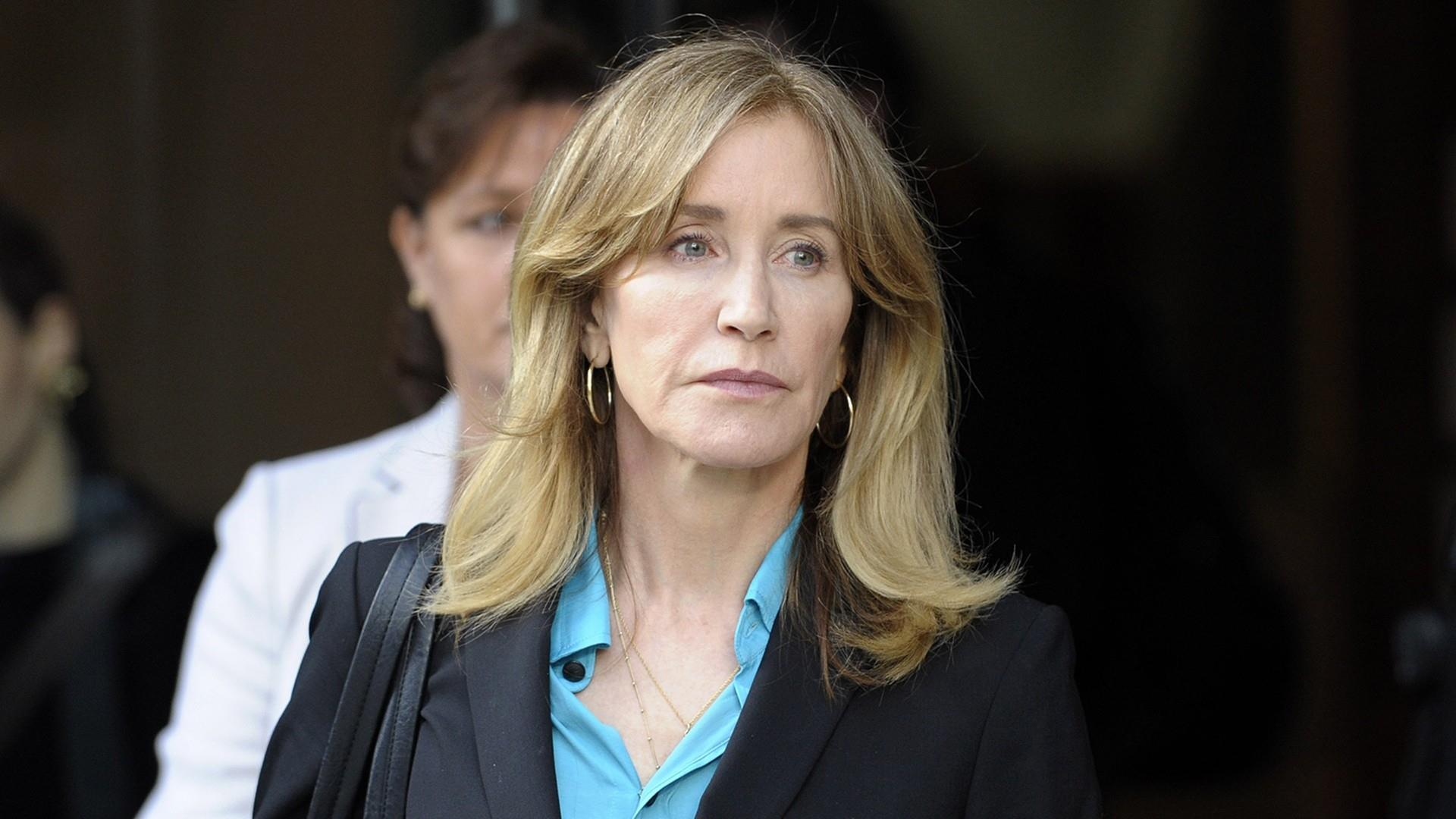 Felicity Huffman reports to prison for sentence in college scandal