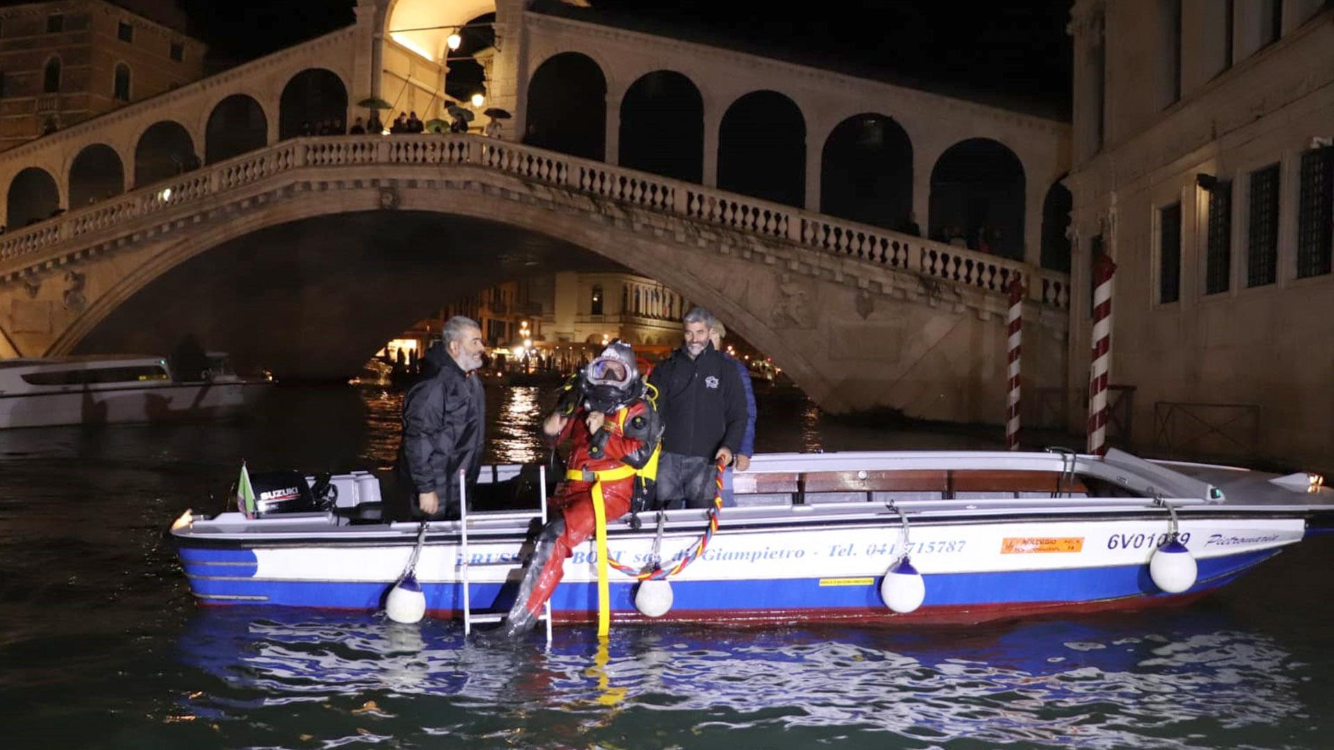 Gondoliers-turned-divers scour famed Venice lagoon and canals for trash