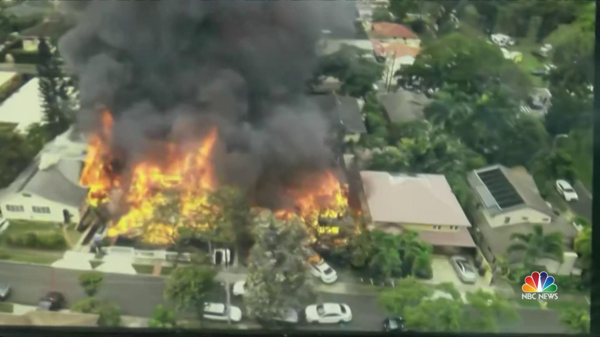 Two police officers fatally shot in Hawaii as nearby homes burn