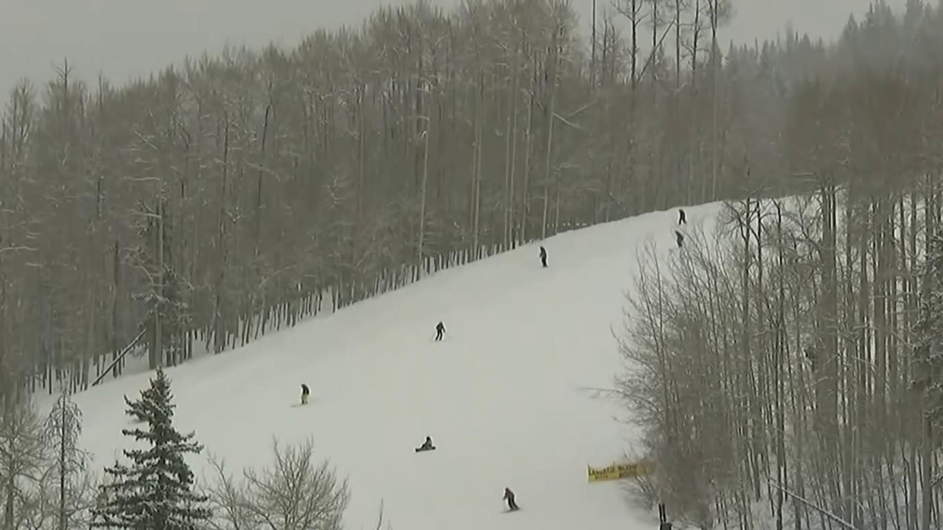 Avalanche kills 2 snowmobilers in Colorado