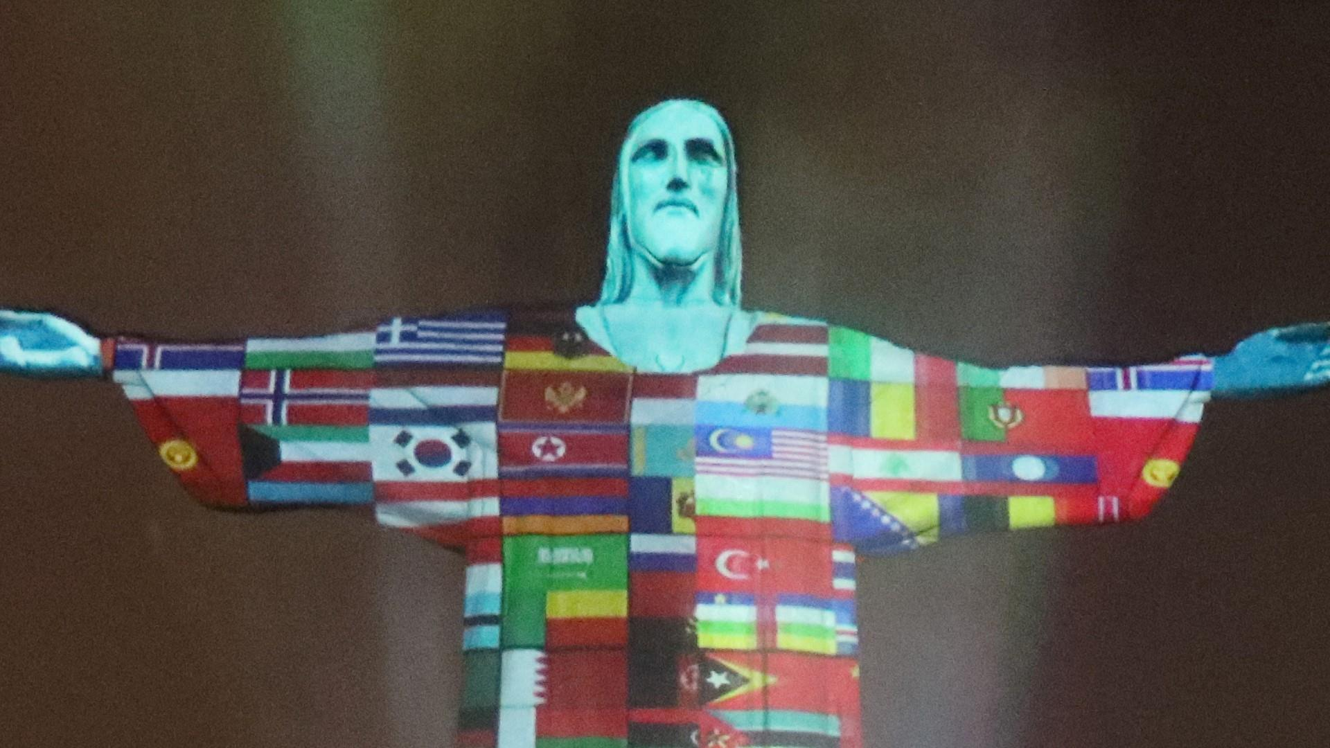 Flags of countries struck by coronavirus projected onto Rio's Christ the  Redeemer