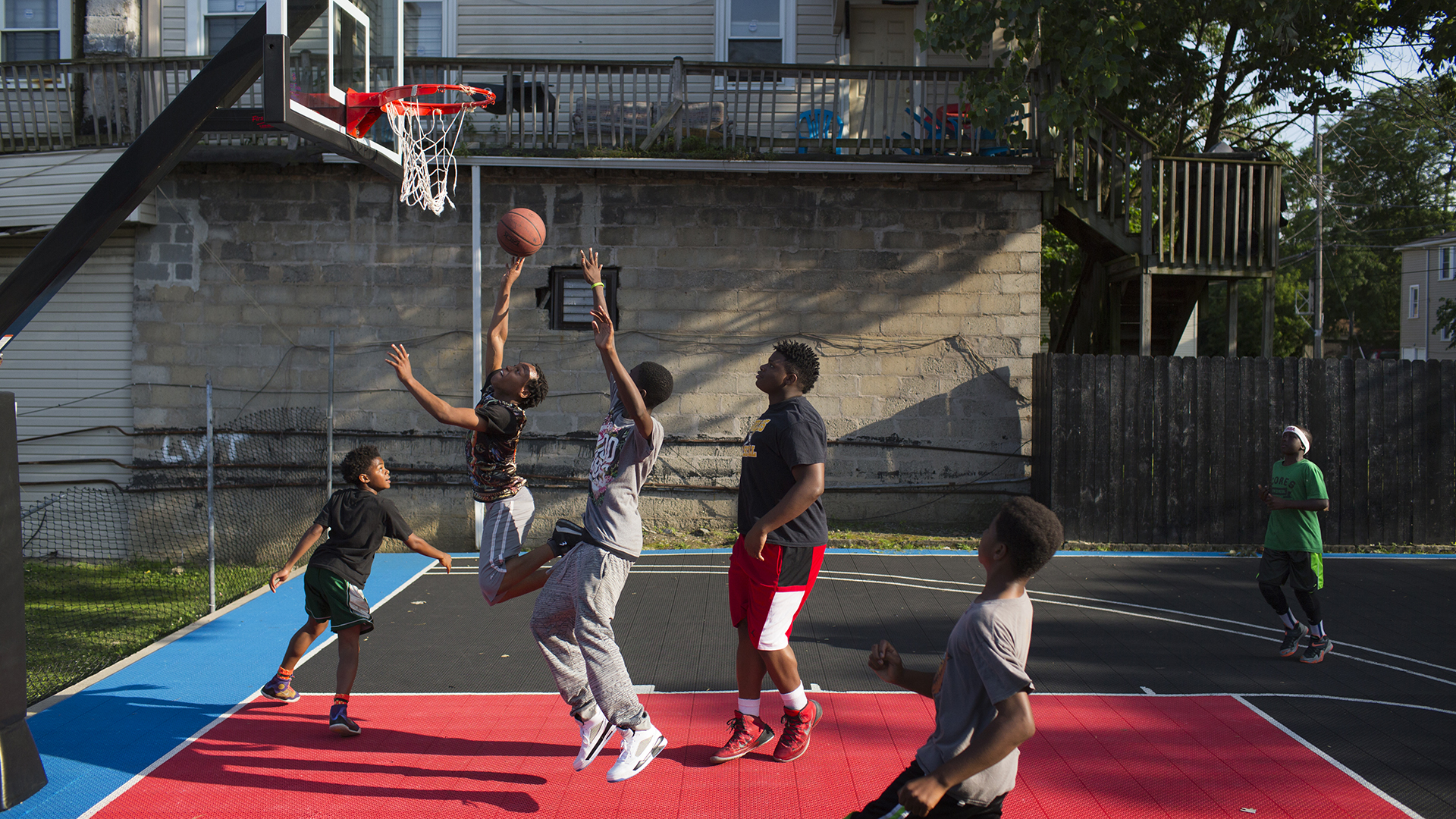 She built a basketball court to offer kids an alternative for Built in basketball court