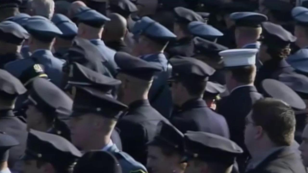 NYPD chief urges respect at officer's wake