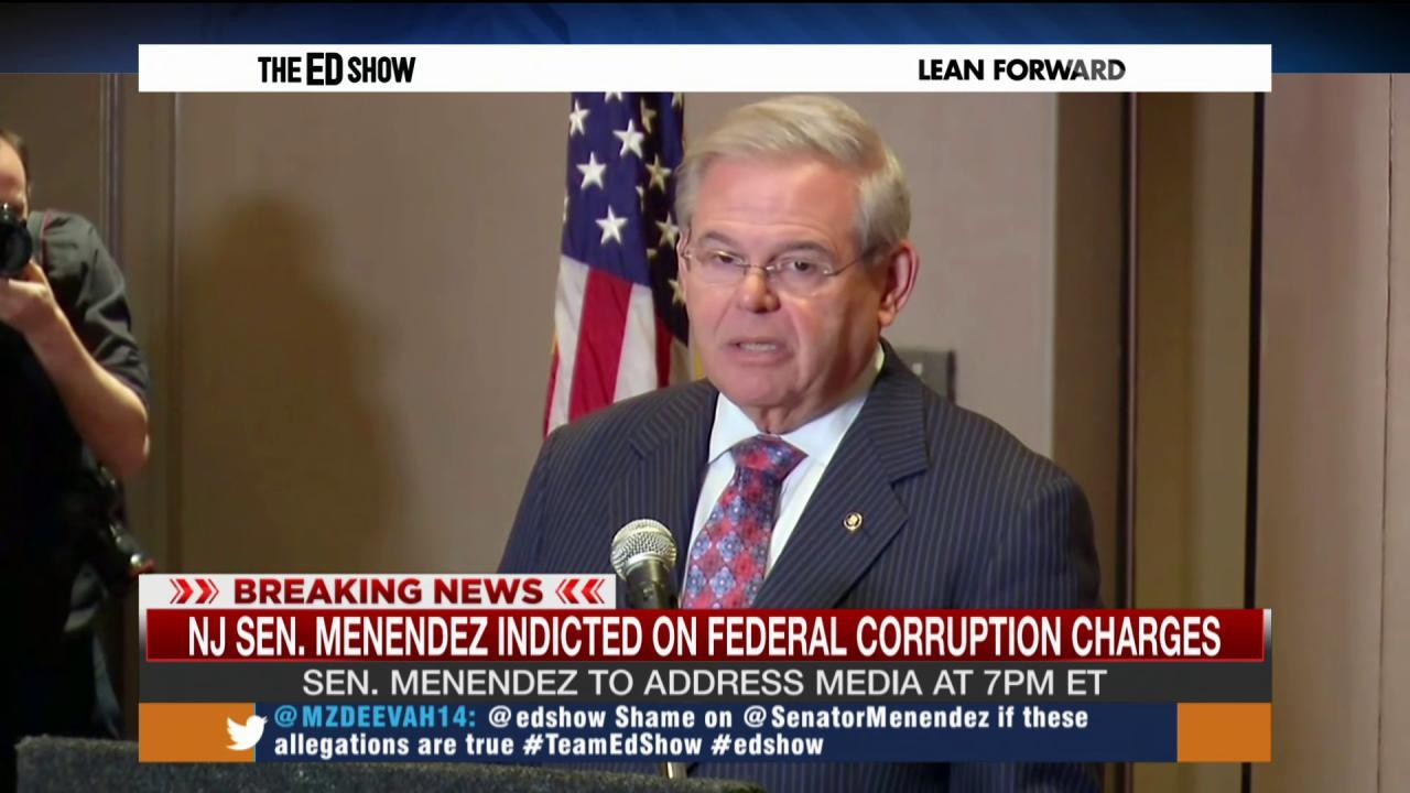 Menendez charged with corruption