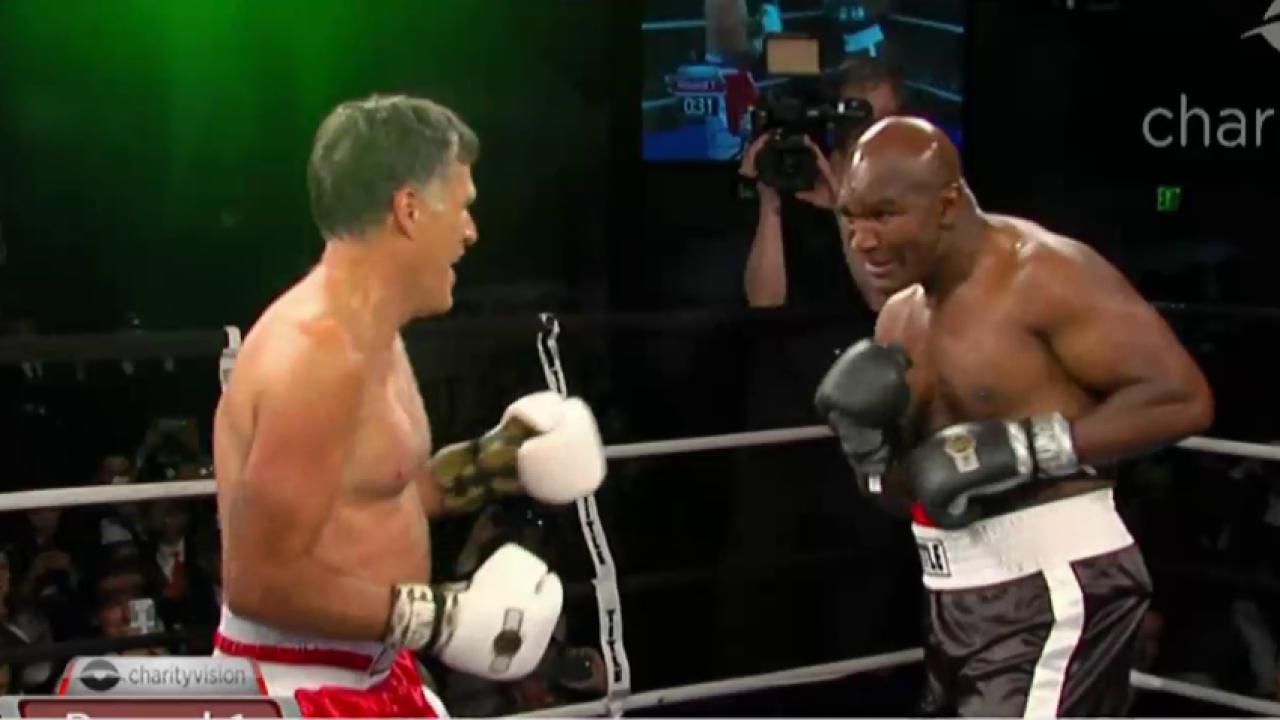 Watch Mitt Romney get in ring with Holyfield