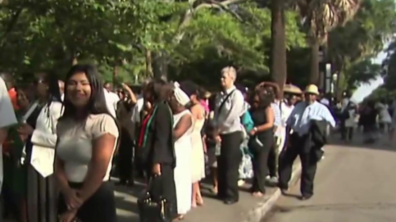 Mourners pay respects to Rev. Pinckney