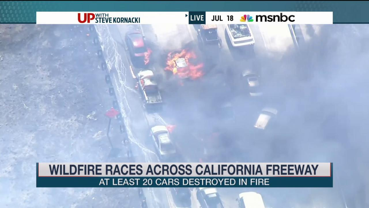 Wildfire races across California freeway