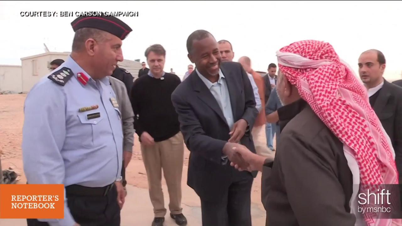 Why did Ben Carson visit a refugee camp?