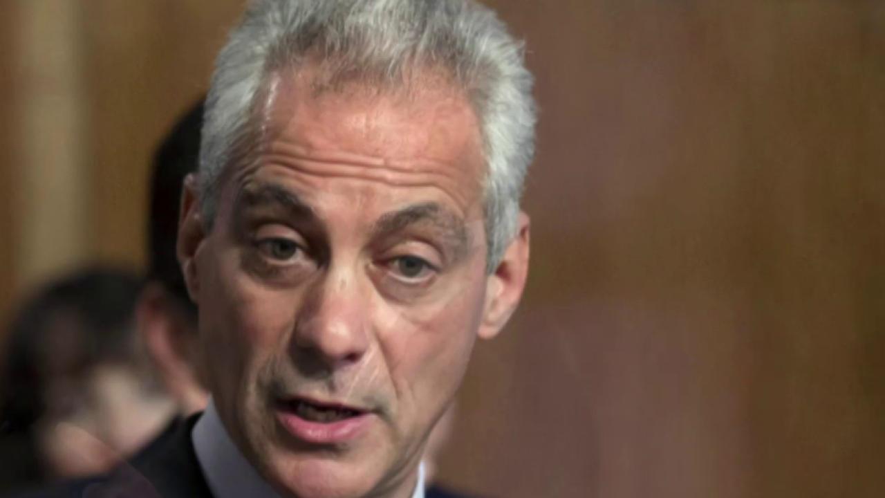 Emanuel returns to work as resignation...