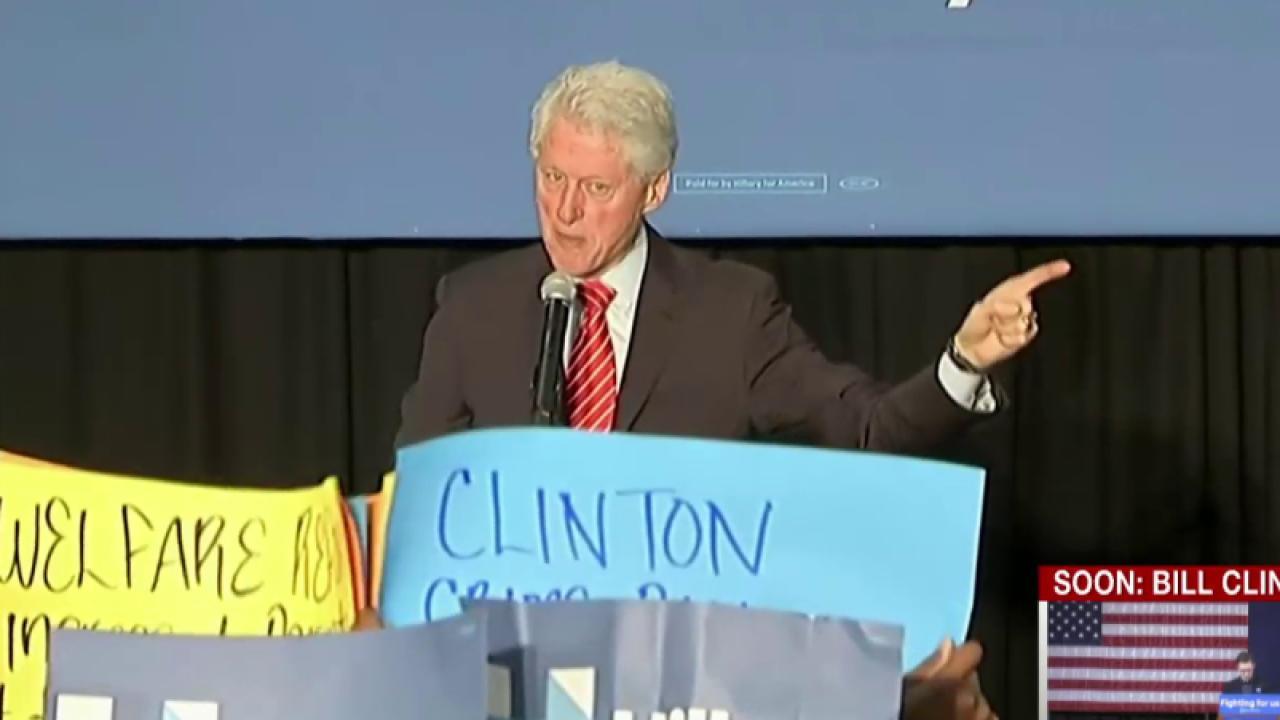 Bill Clinton defends crime bill to protesters