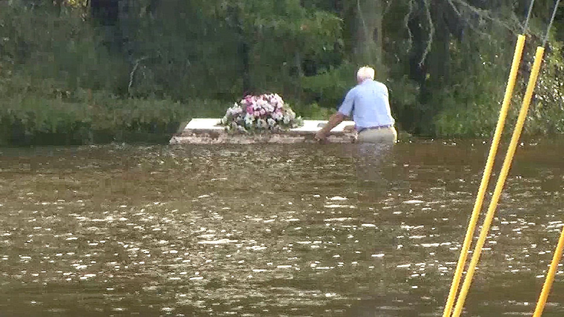 pastor reeves wades in the water to stop casket floating away nbc news
