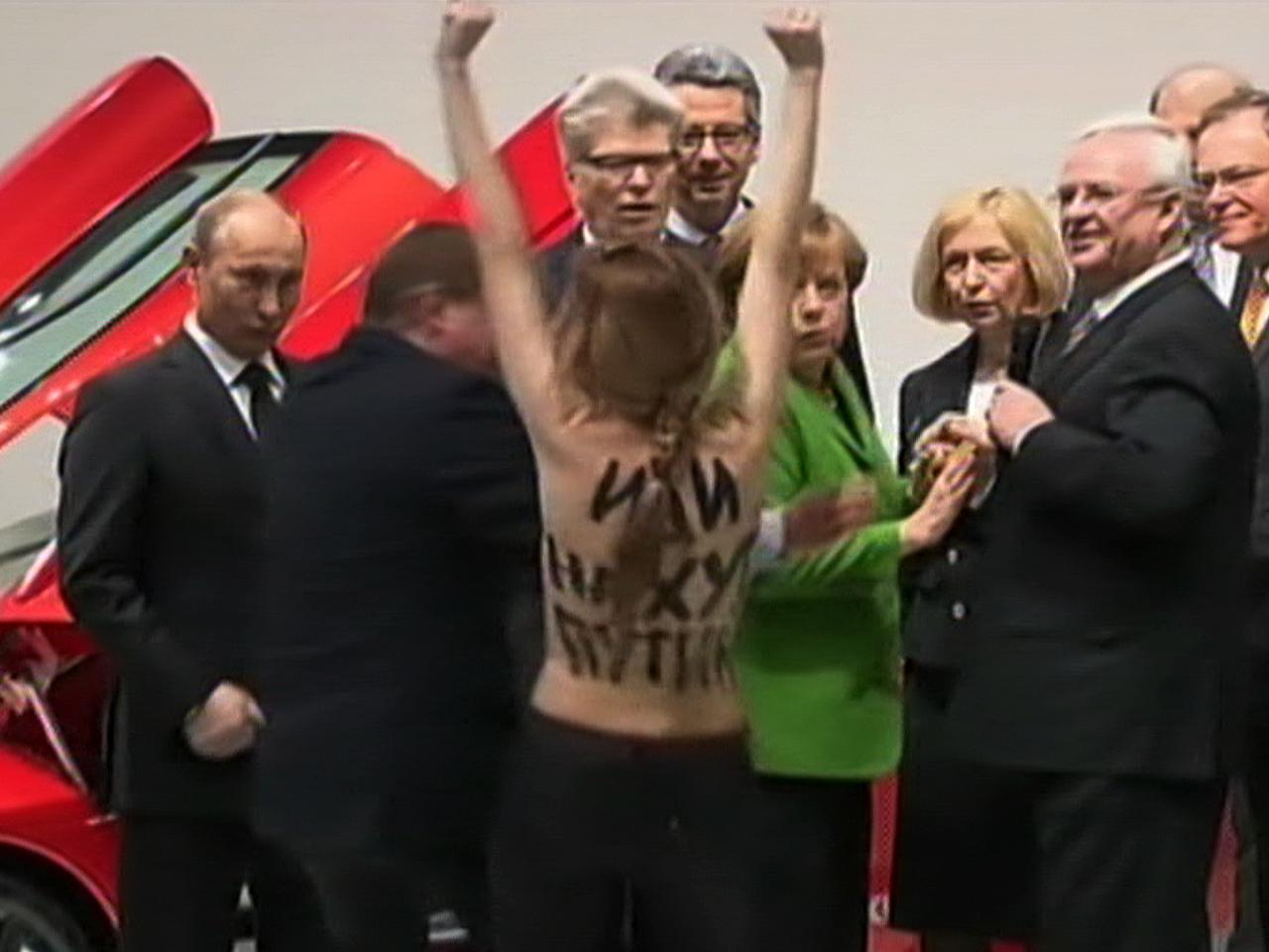 Angela Merkel Topless topless protesters bust up putin, merkel event