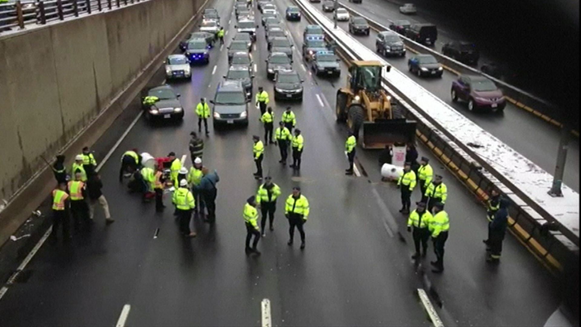 Watch Protesters Shut Down Major Mass  Highway