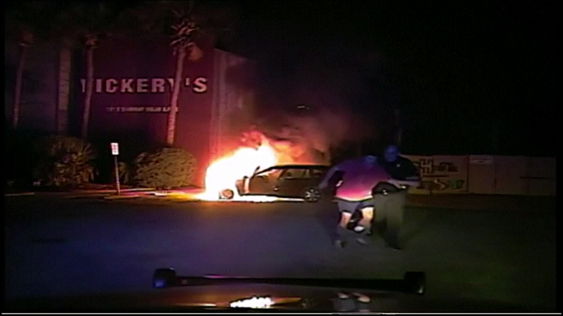 Police officer saves man from burning car