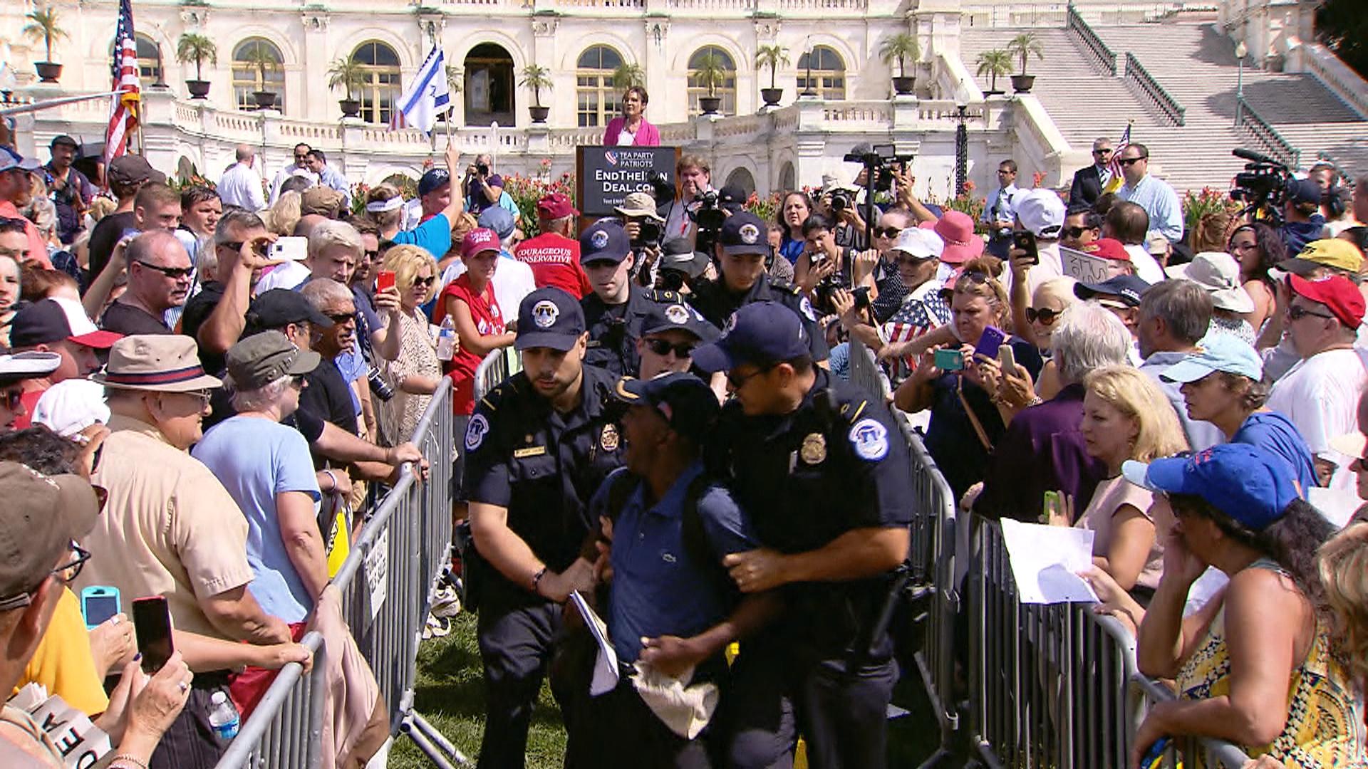 Heckler escorted away from Sarah Palin speech