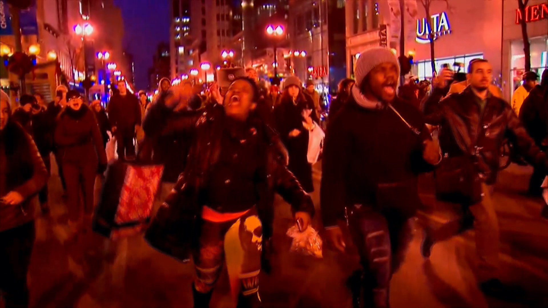Protesters march in larger numbers in Chicago