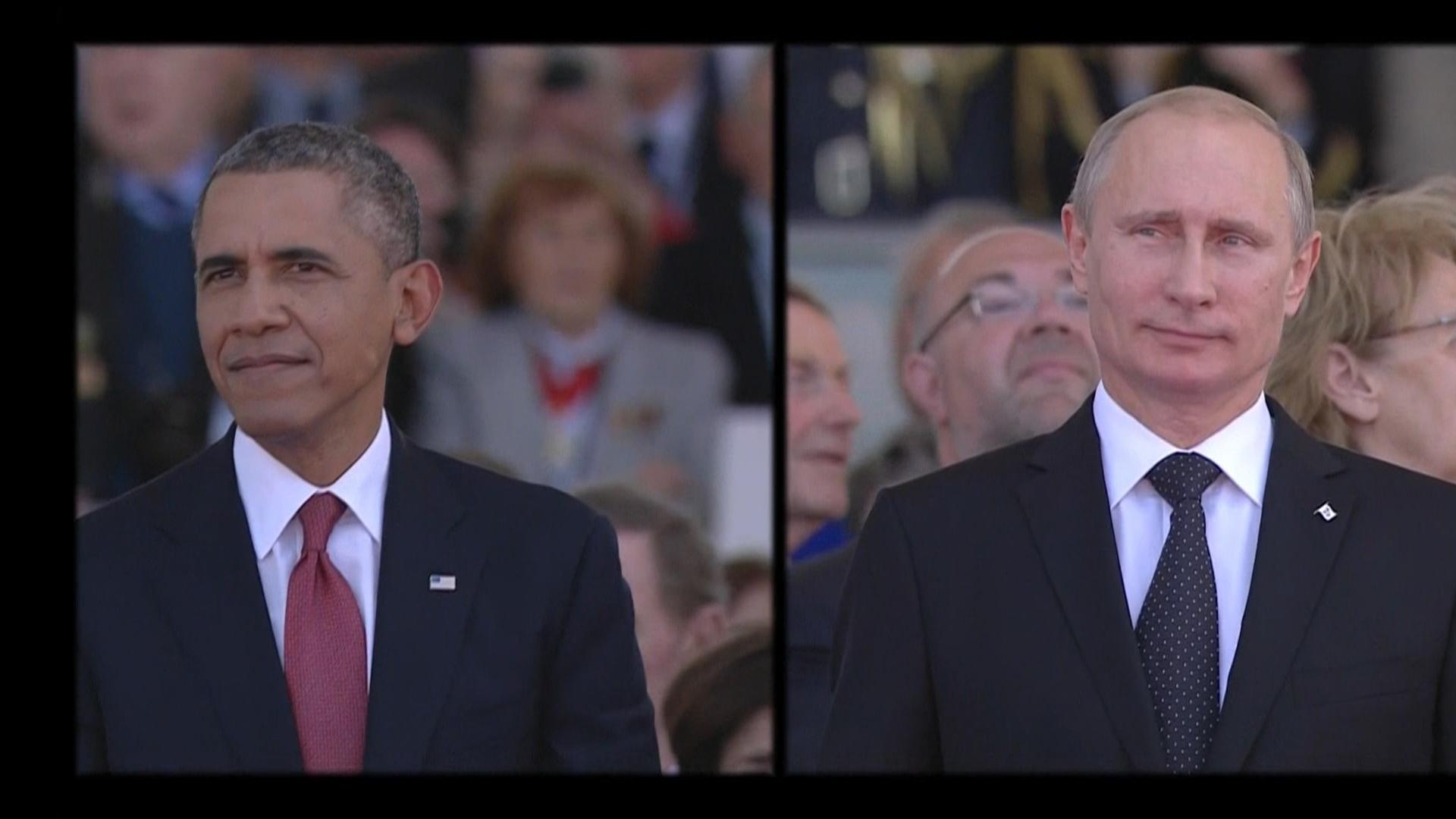 Obama, Putin meet during D-Day ceremonies