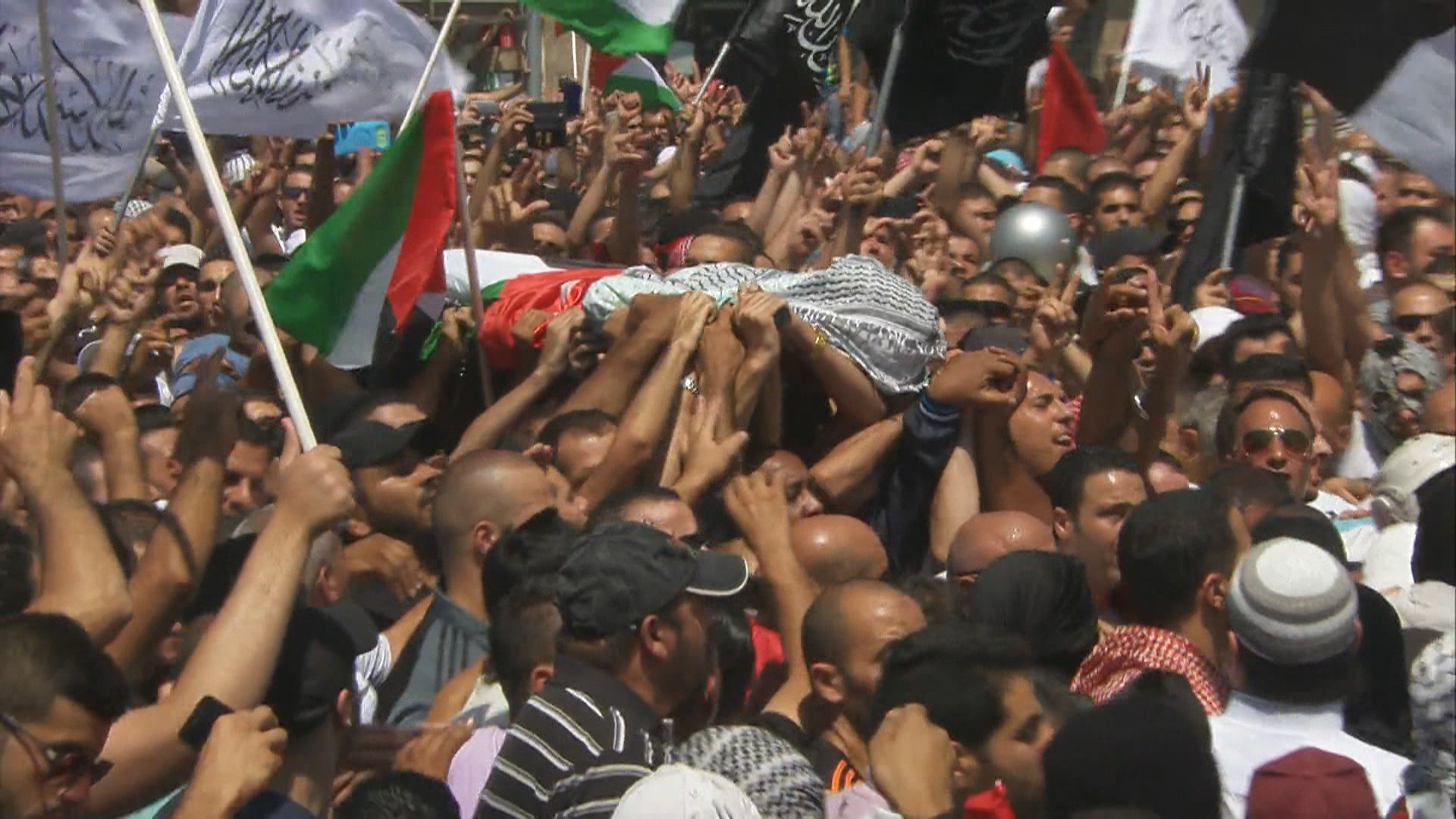 Body of Slain Palestinian Teen Carried Through Tense Jerusalem