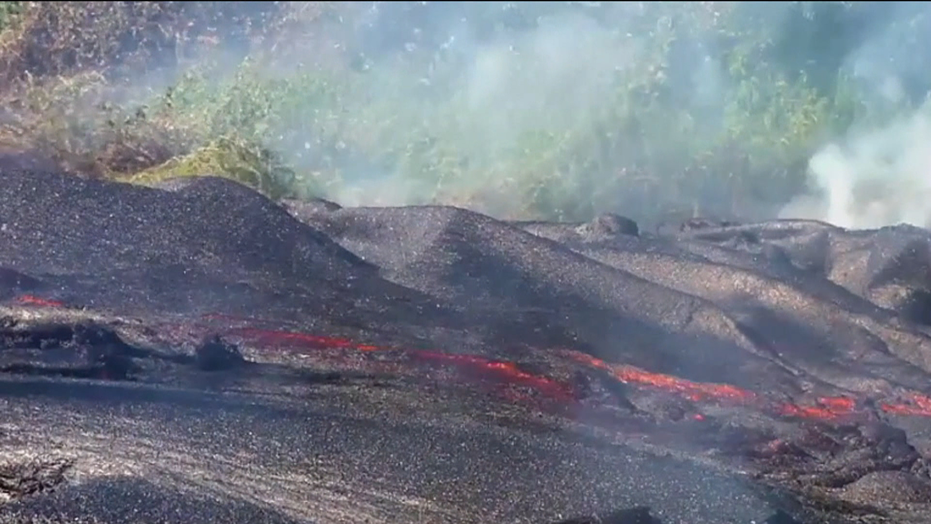 Hawaii Volcano Lava Rolls Through Cemetery as It Appoaches Village