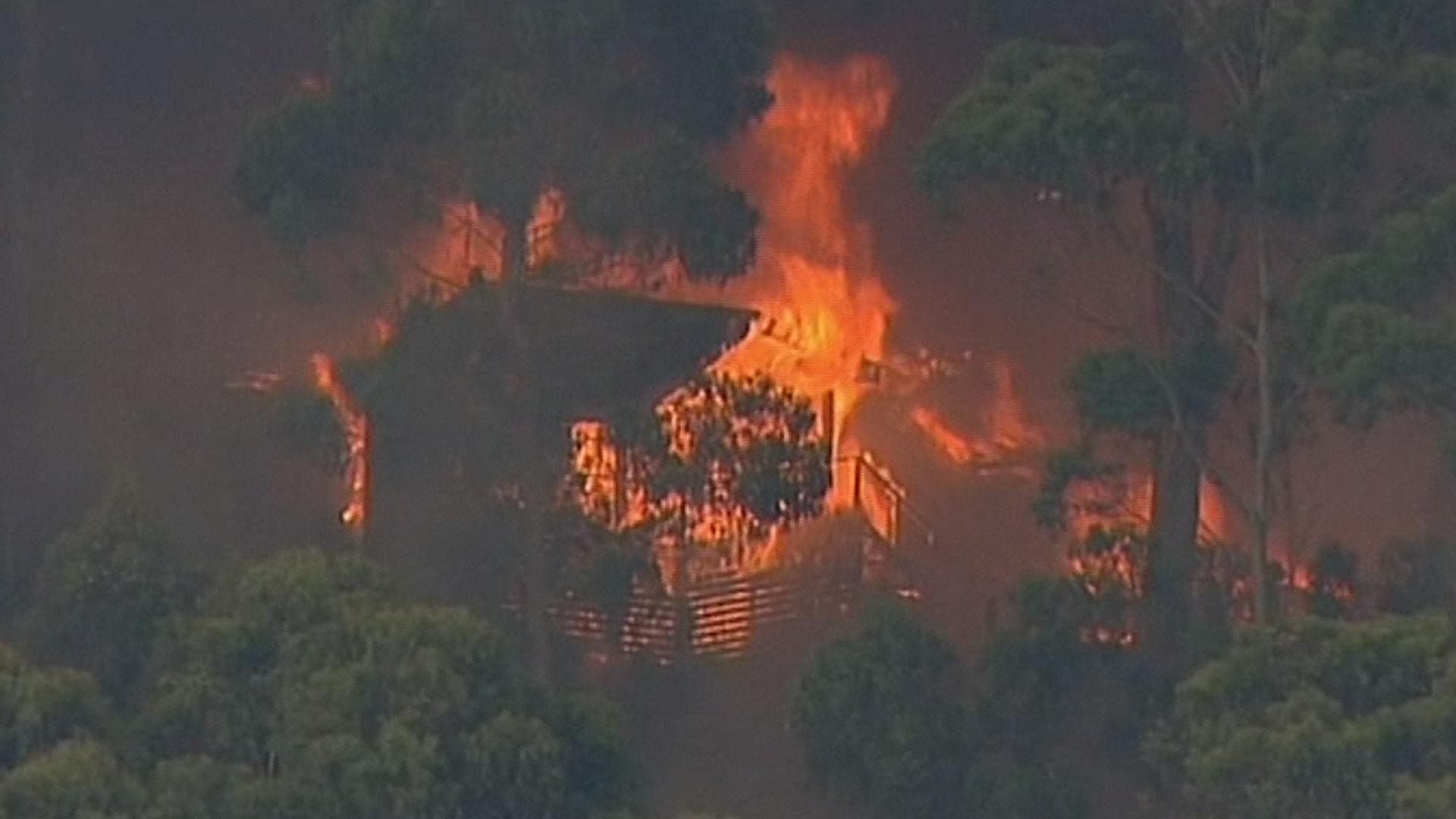 Wildfires Rage Near Australian Tourist Towns