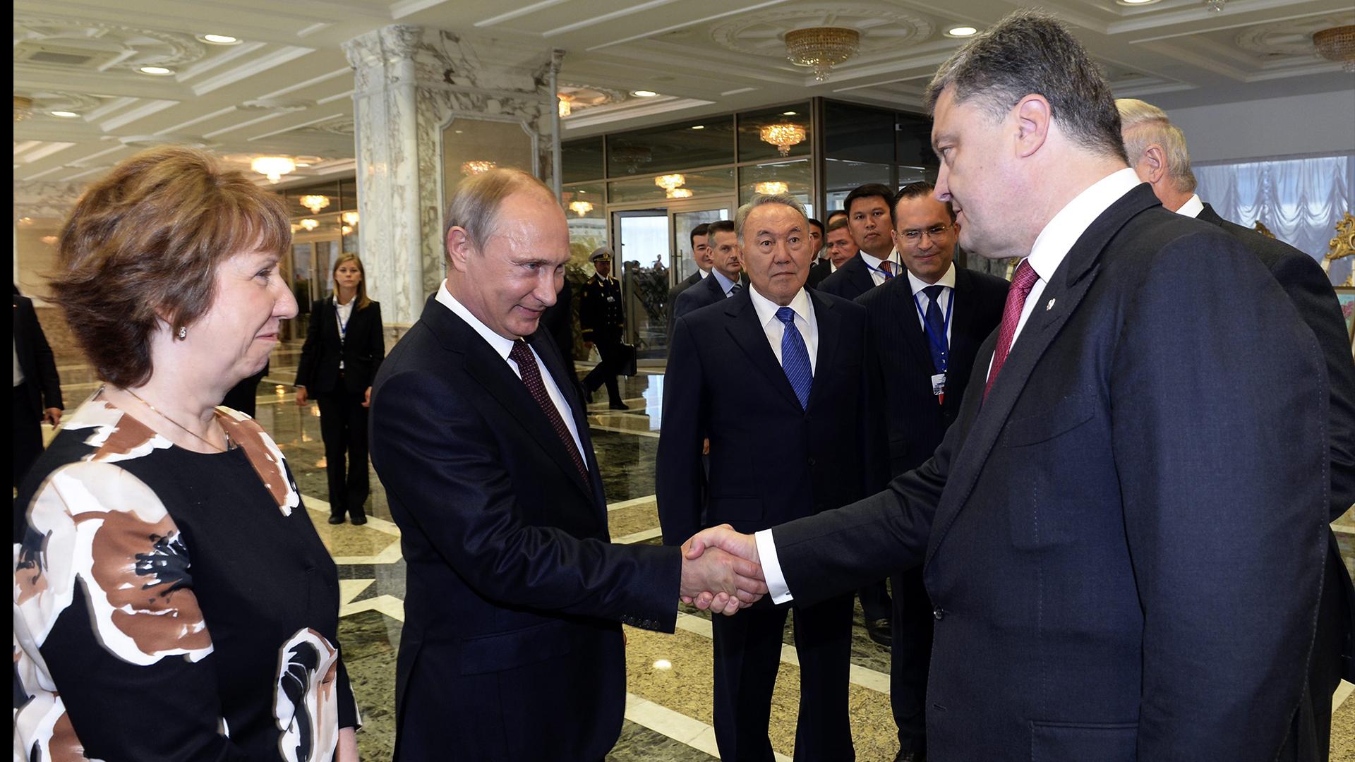 Russia's Putin, Ukraine's Poroshenko Shake Hands At Minsk Talks
